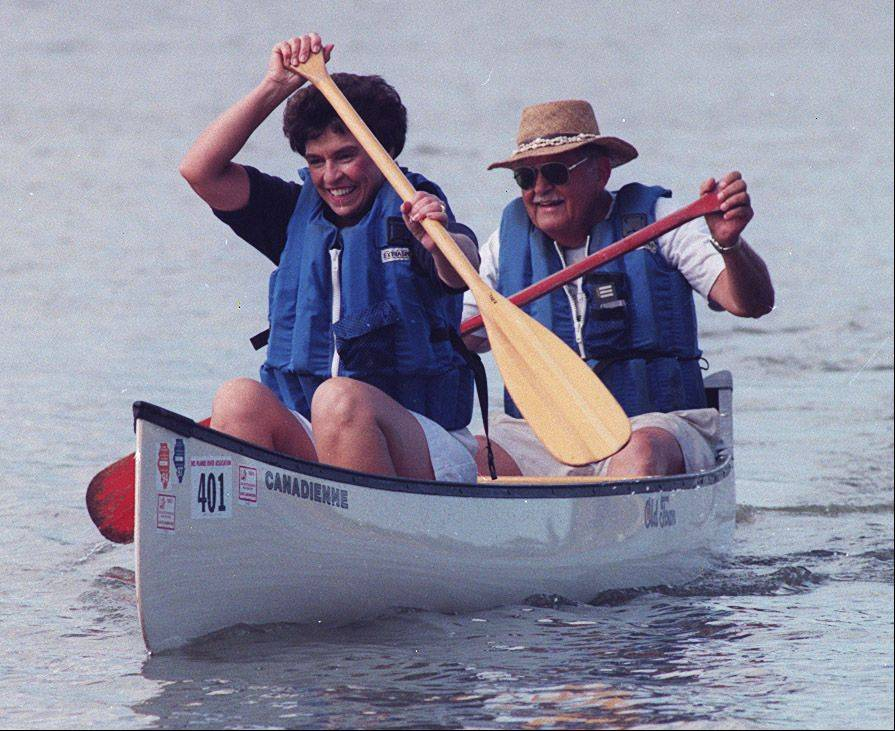 Arlington Heights Village President Arlene Mulder and canoe partner Bob Zember put their hearts into the 1999 Lake Arlington canoe race sponsored by the Lions Club.