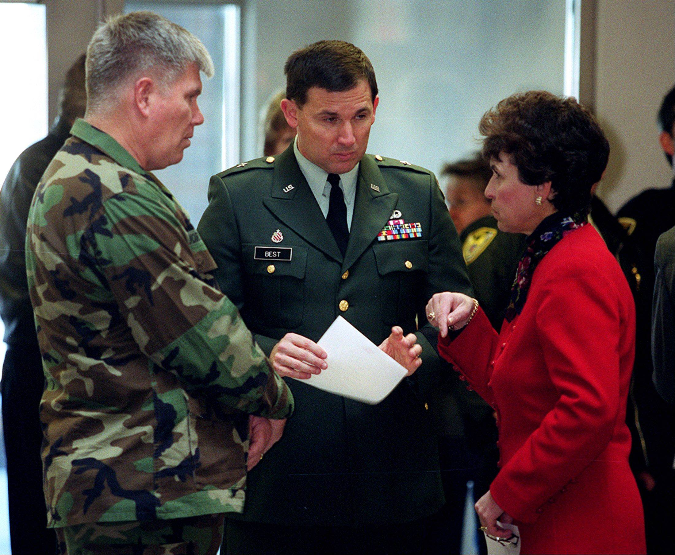 Col. Charles Jorgenson, left, and Brig. Gen. Steve Best talk to Arlene Mulder in the lobby of the new Army Reserve Center in Arlington Heights during the dedication ceremony of the $16 million center on Nov. 19, 2002.