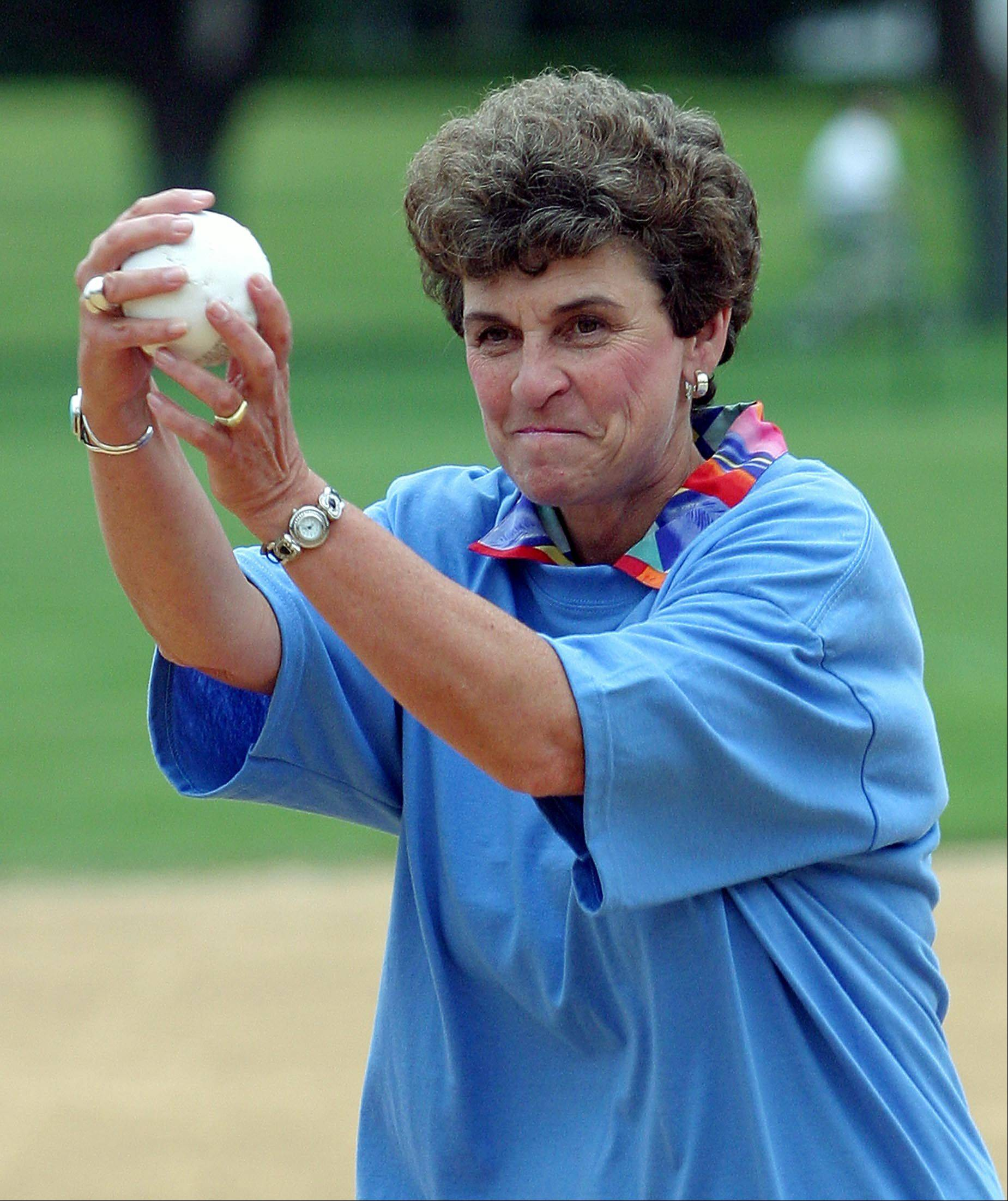 Arlene Mulder warms up for the ceremonial first pitch at the annual Million Week softball game between Arlington International Racecourse employees and Arlington Heights police officers in Pioneer Park, on Aug. 11, 2003.