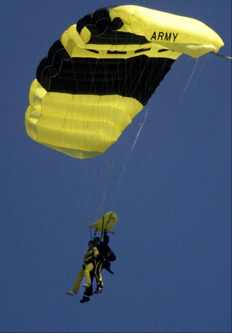 Arlington Heights Mayor Arlene Mulder (front, in yellow jumpsuit) floats to the ground with U.S. Army Golden Knight SFC Bryan Schnell. With Schnell, she jumped from 13,000 feet on Aug. 21, 2004 at the Skydive Chicago event in Ottawa, IL, that was featuring jumps for local celebrities and politicians.
