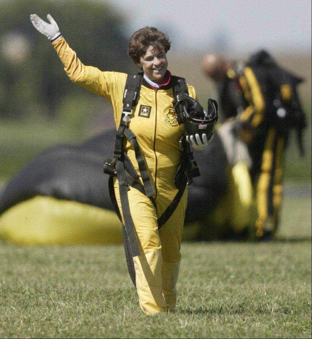 A thrilled Mulder signals to the crowd that she is okay after a safe landing.