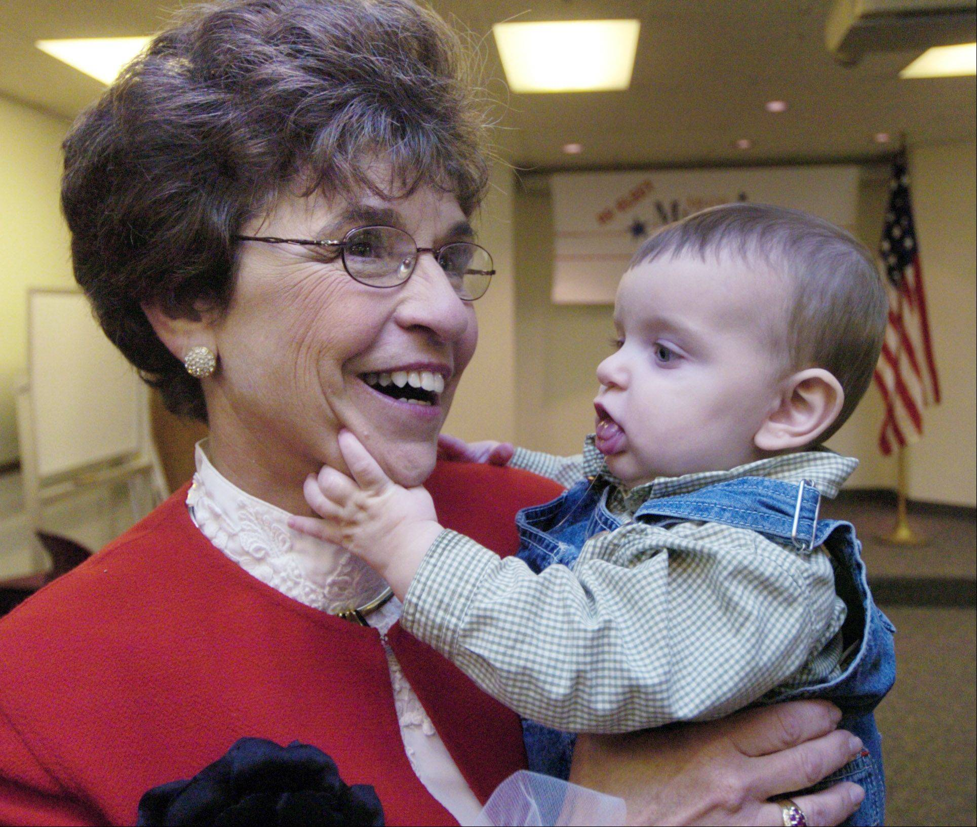 Arlene Mulder's 6-month-old grandson, Ethan, visits with her on Oct. 12, 2004 at the Arlington Heights Historical Society, where she announced she was running for a fourth term.