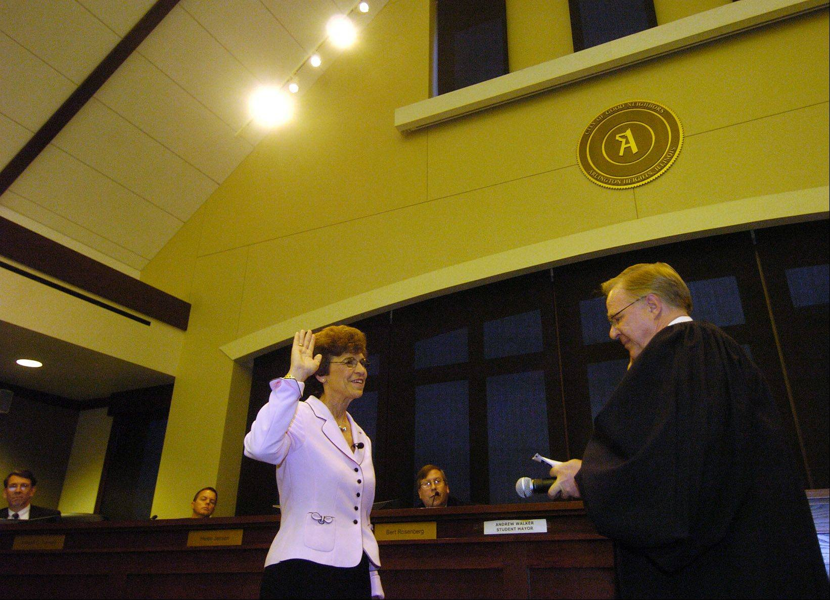 Judge William Maki swears the mayor into office for the final time, on May 4, 2009.