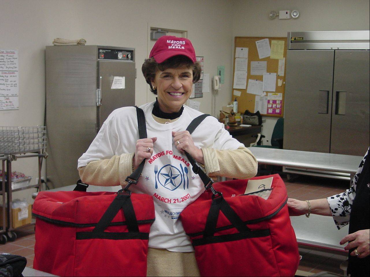 Arlene Mulder gets geared up to deliver meals to seniors on Mayors for Meals Day, March 21, 2007. The national day was set aside to raise awareness of senior hunger.