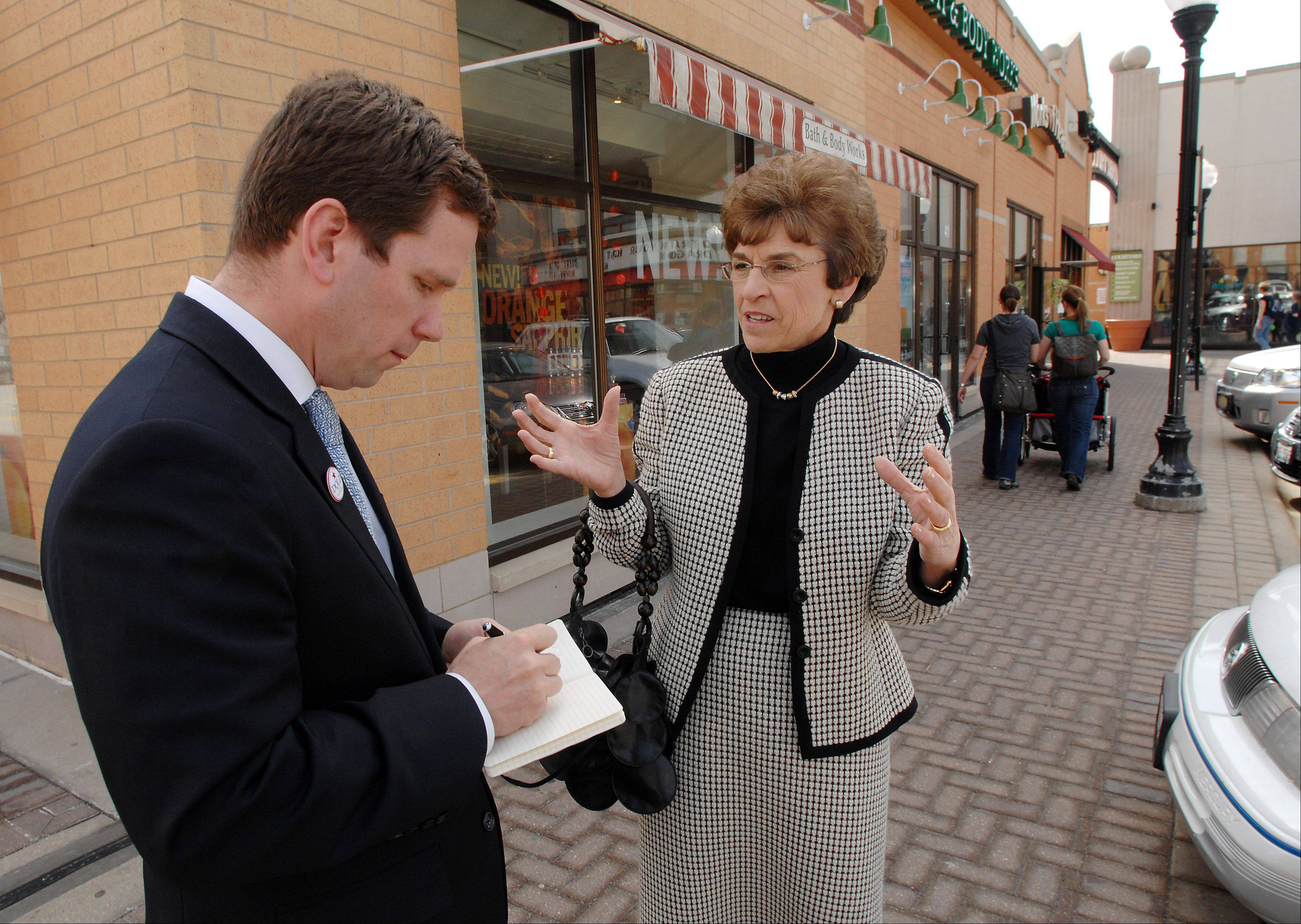 Arlene Mulder gives then-Congressman Bob Dold a tour of downtown Arlington Heights in March 2010, talking with residents and business owners about ways to improve the area.