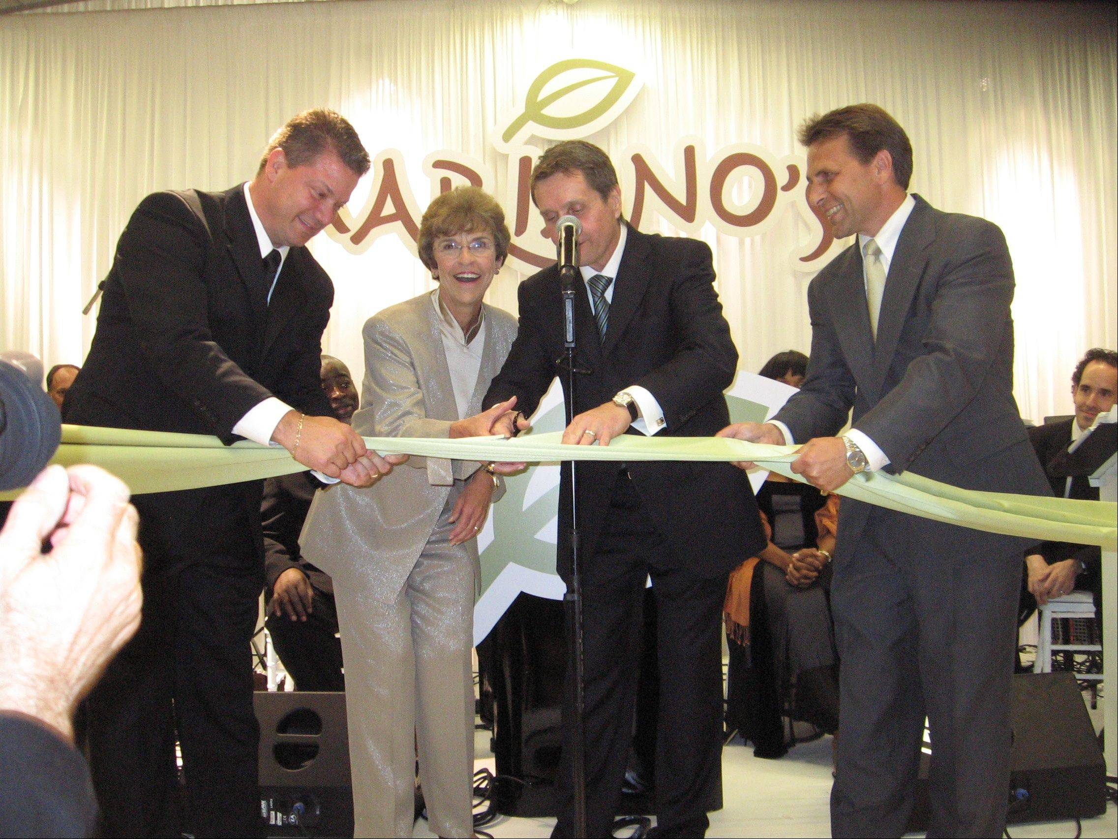 The opening of Mariano's Fresh Market on July 19, 2010 is celebrated by, from left: store Co-Director Greg Vengrin; Village President Arlene Mulder; Mariano's Chairman Bob Mariano, and store Co-Director Ken Szymanski.