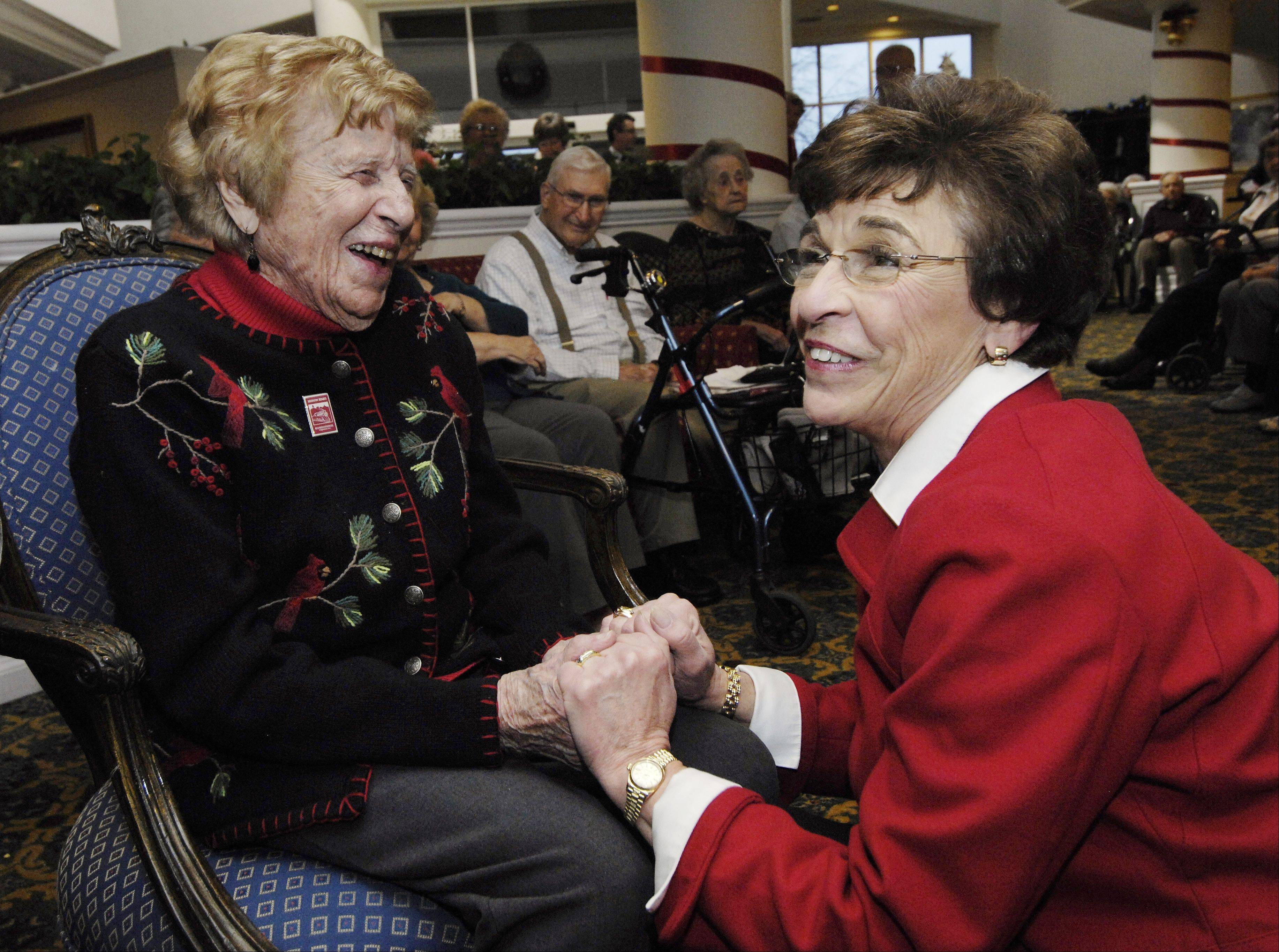 Arlene Mulder, right, visits with Lois Arbanas as she celebrates her 105th birthday at the Moorings on Dec. 1, 2012. Mulder recognized Arbanas on her 100th birthday with a plaque, and added to that collection with another framed certificate of recognition last December.