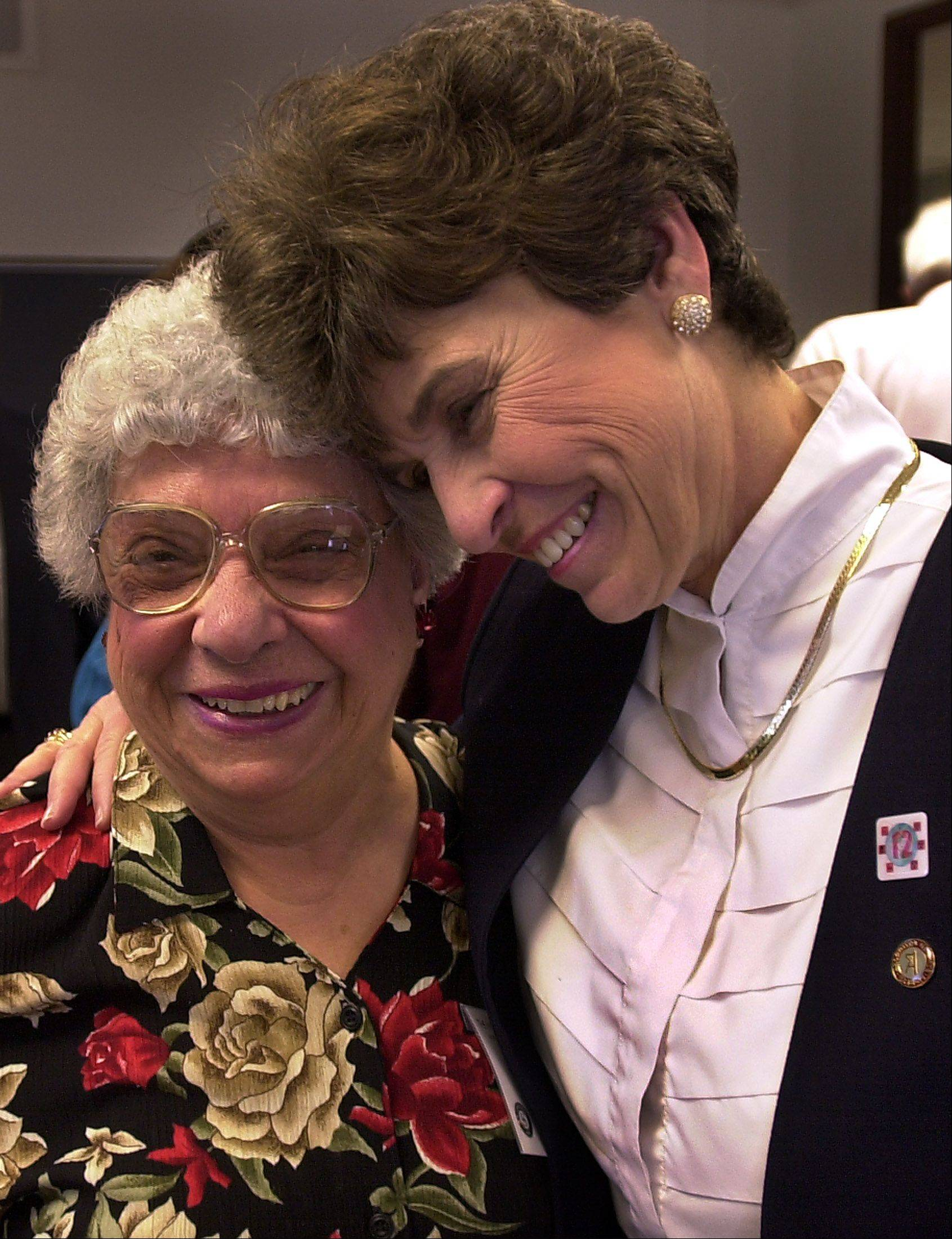 Longtime Arlington Heights volunteer Grace Fiebig and Mayor Arlene Mulder share a hug at a 2003 volunteer celebration hosted by The Volunteer Center (now HandsOn Suburban Chicago). Fiebig, now 93 and still active, attended Mulder's farewell party on April 28, 2013.