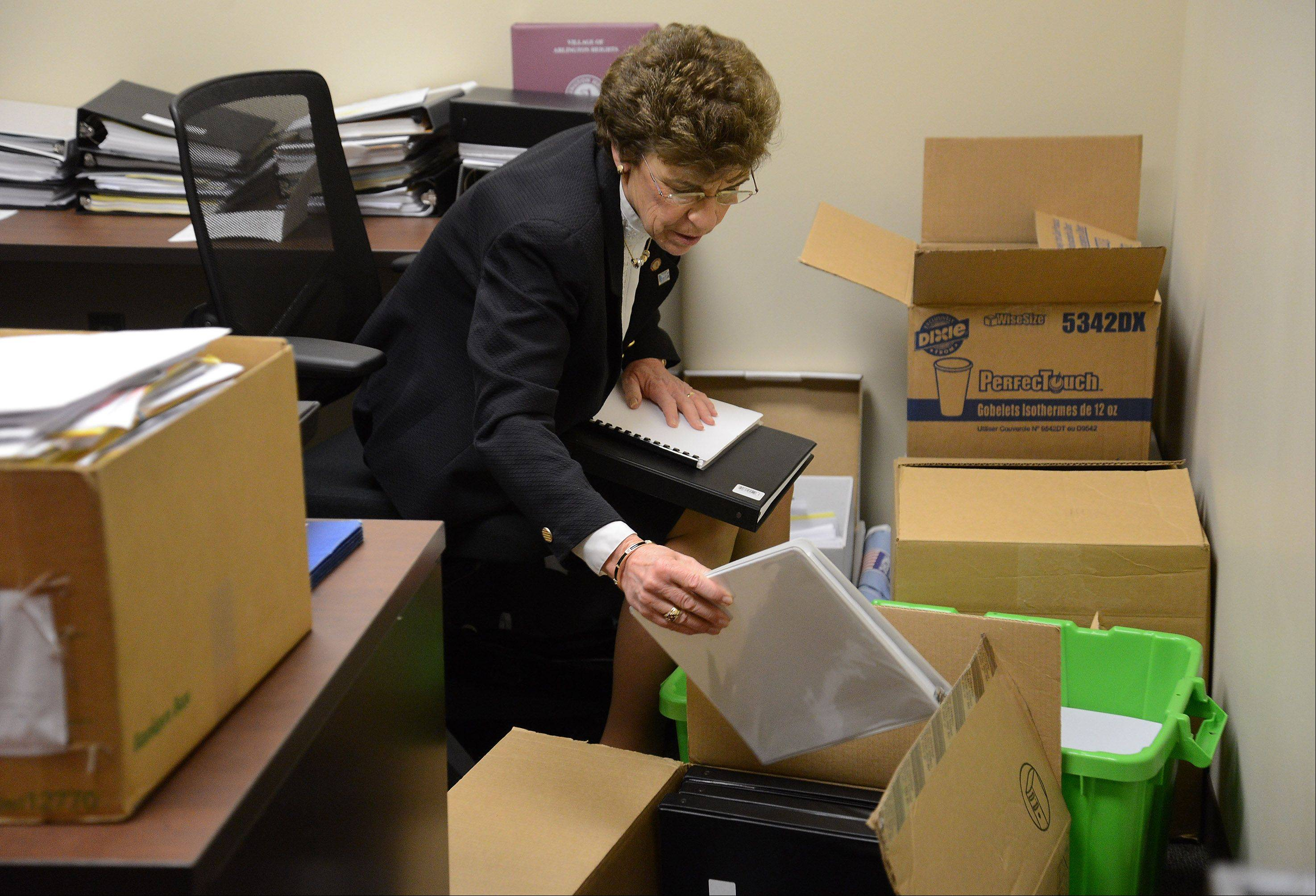 Outgoing Arlington Heights Mayor Arlene Mulder cleans out her temporary office.