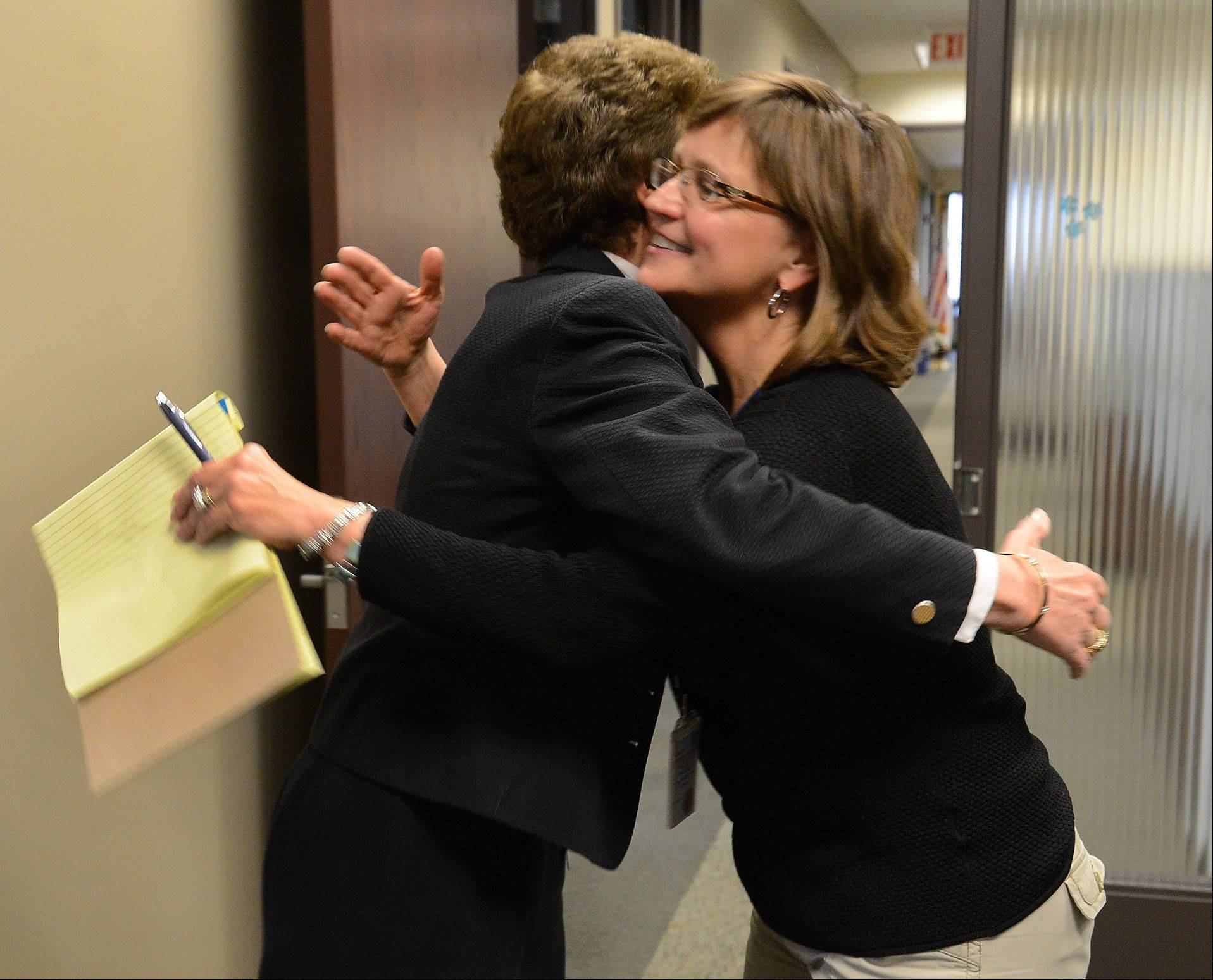 Outgoing Arlington Heights Mayor Arlene Mulder gets a hug from Village Human Resources Director Mary Rath.