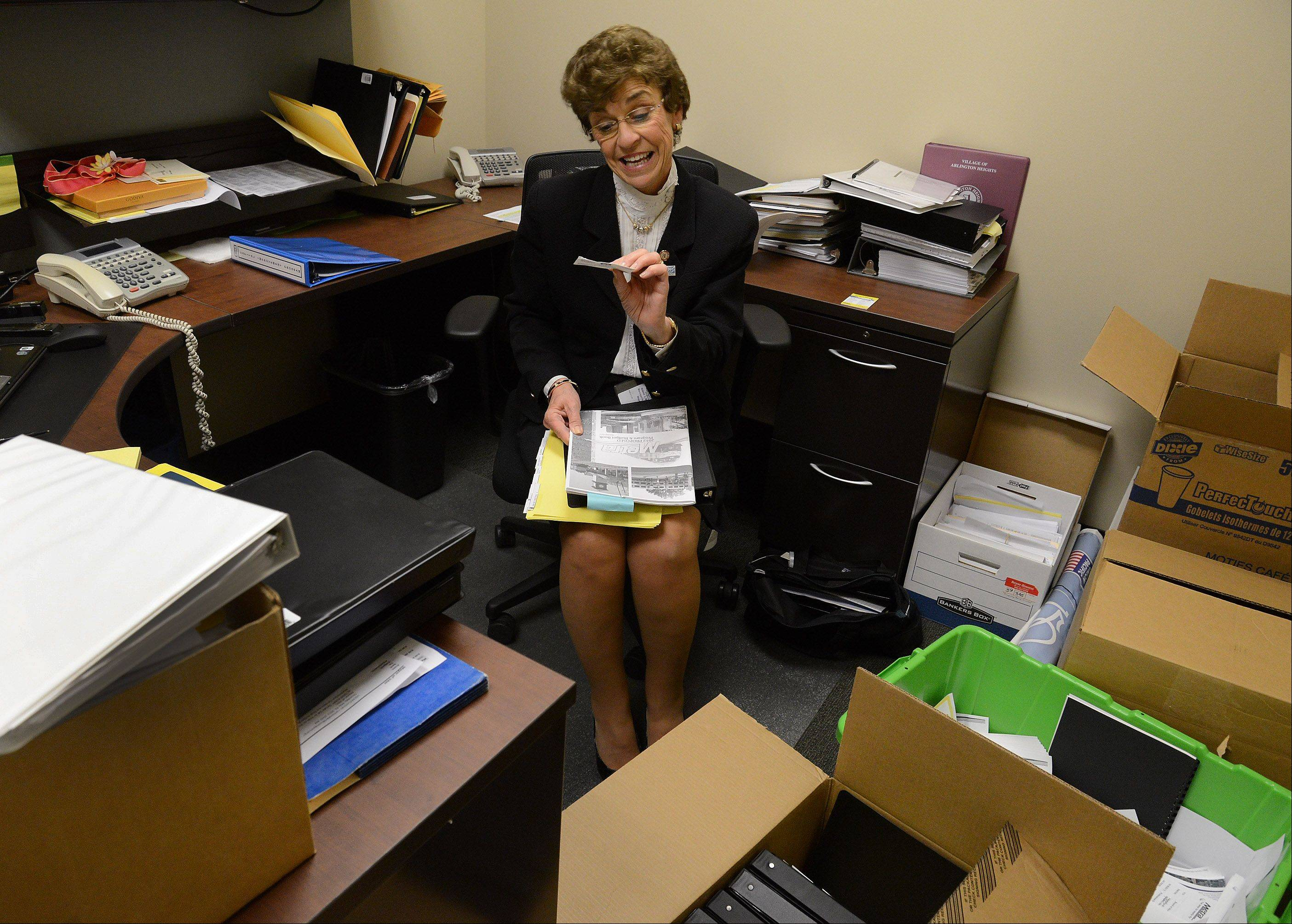 Outgoing Arlington Heights Mayor Arlene Mulder finds something of interest while cleaning out her temporary office.