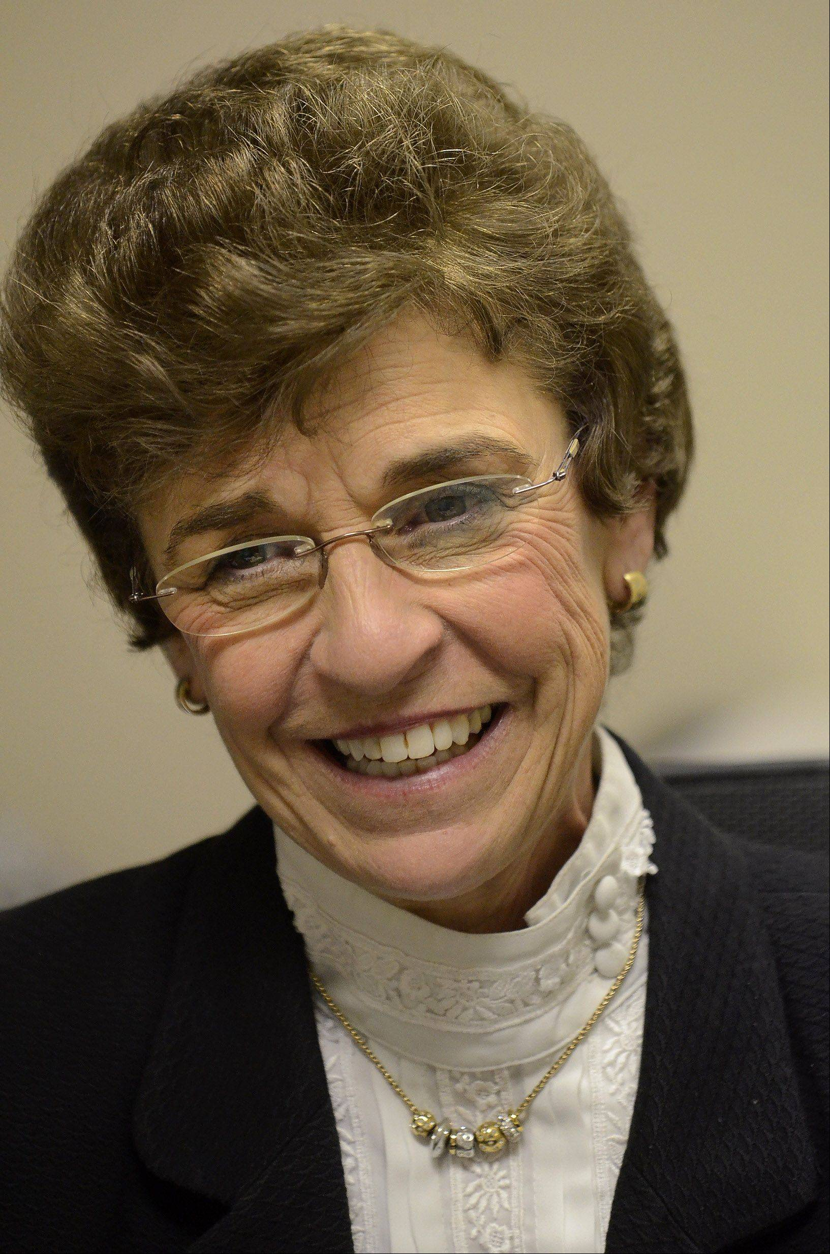 Outgoing Arlington Heights Mayor Arlene Mulder smiles Friday.