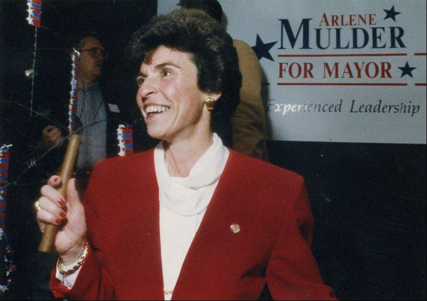 On April 20, 1993, Arlene Mulder is elected to her first term as village president. She holds a victory cigar given to her from friend and supporter Ken Cook.