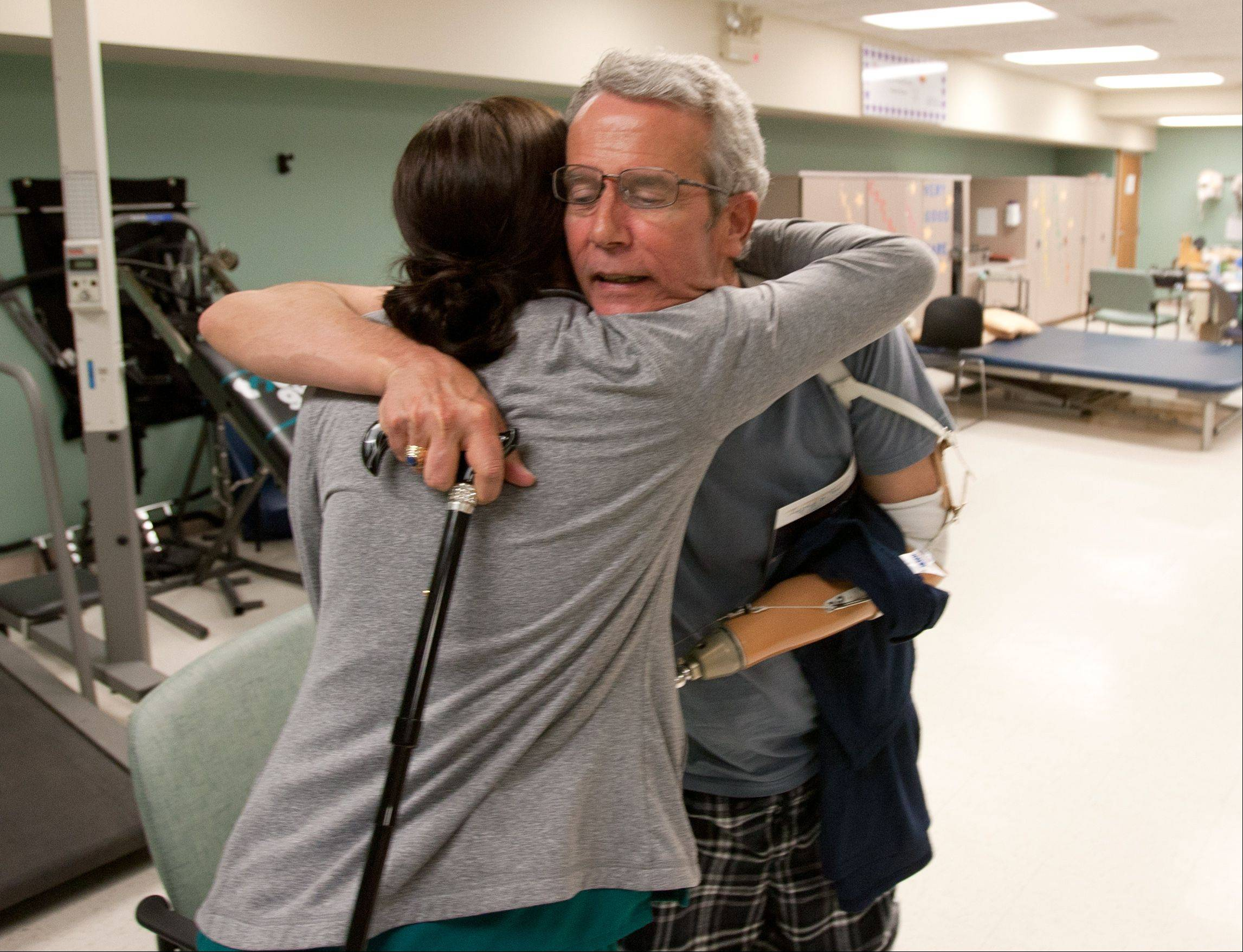 Carson gives a farewell hug to physical therapy student Erin Barry during his last session at the Advocate Christ Medical Center in Oak Lawn.
