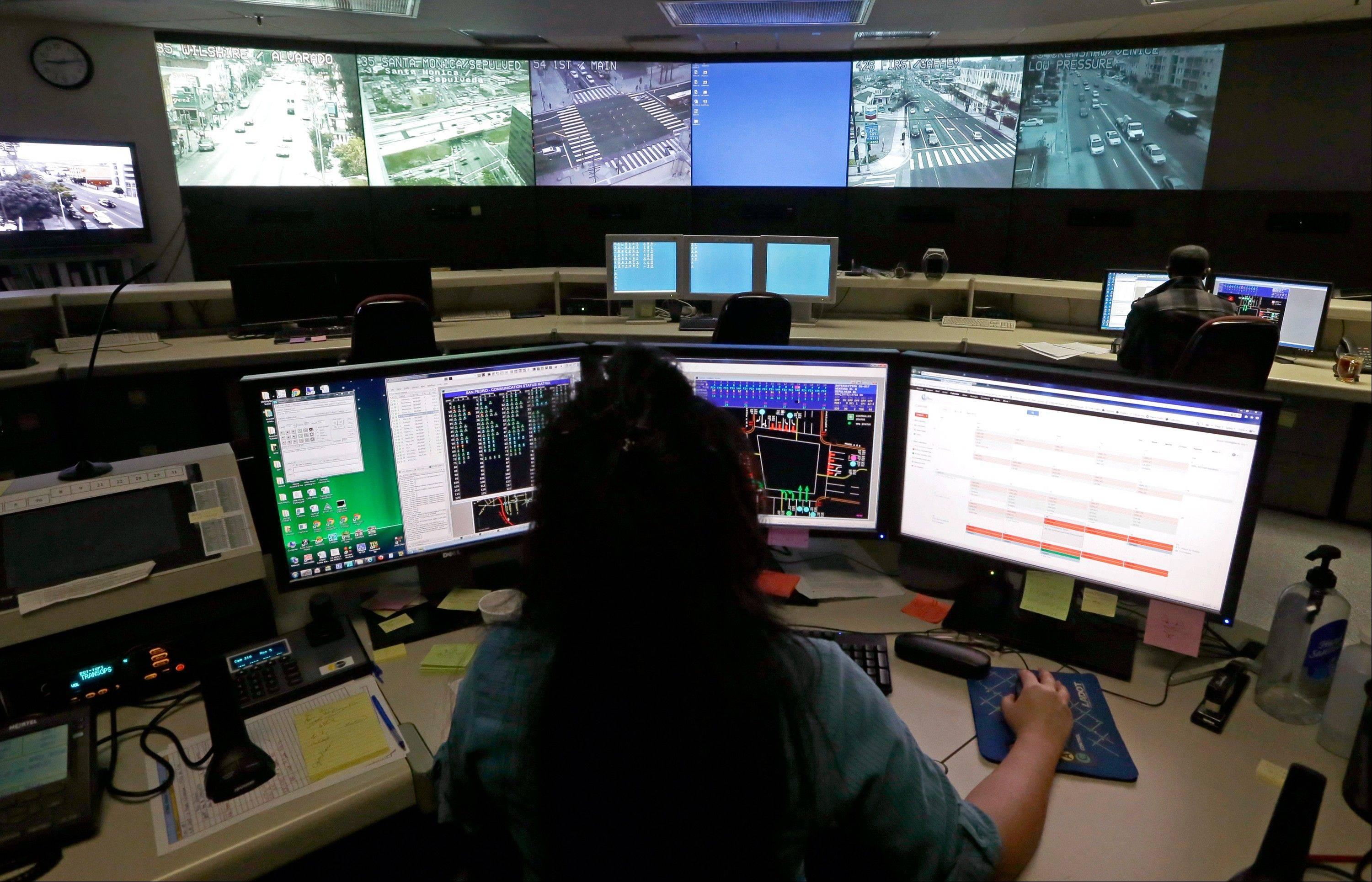 A transportation engineer monitors footage at the Los Angeles Department of Transportation's Automated Traffic Surveillance and Control Center in downtown Los Angeles. In small towns and big cities, police and politicians are pointing to the surveillance video that was key to identifying the Boston Marathon bombing suspects as a reason to bolster their own networks and get more electronic eyes on their streets.