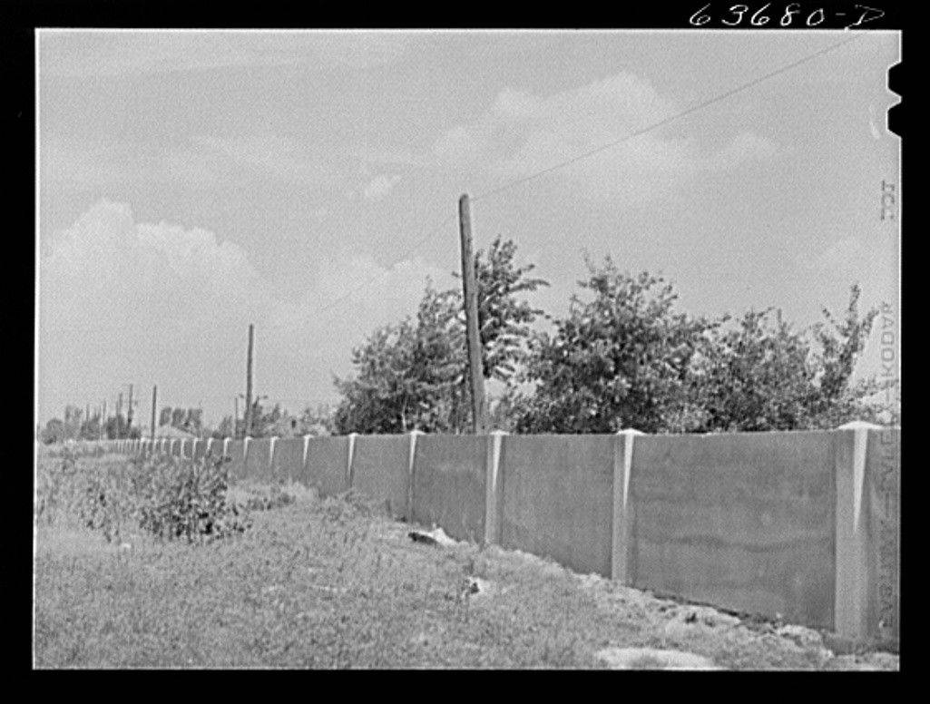 This 1941 photo shows a half-mile concrete wall in Detroit that was built to separate homes planned for middle-class whites from blacks who had already built small houses.