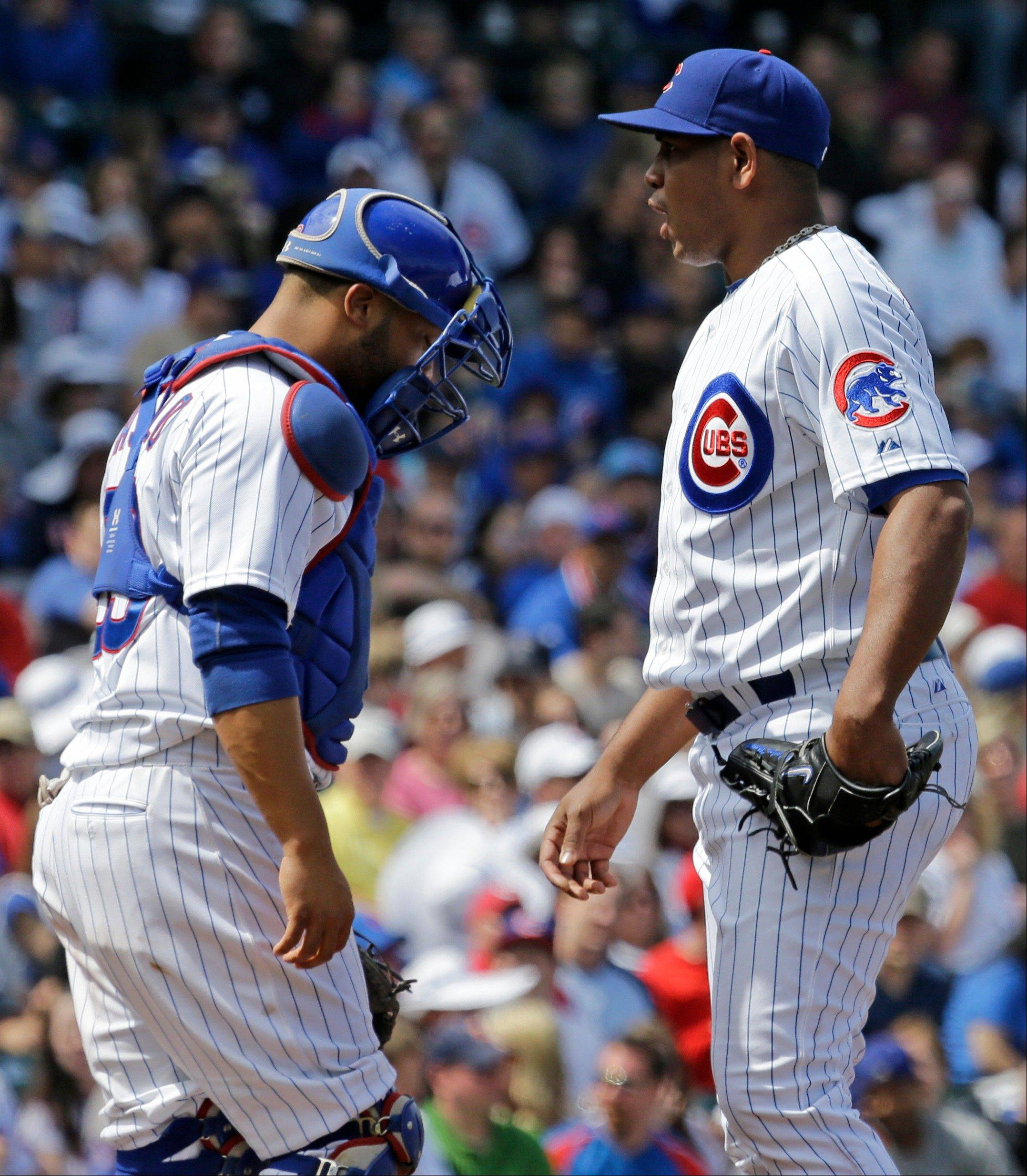 Cubs relief pitcher Carlos Marmol talks with catcher Welington Castillo during a rough appearance Saturday. On Sunday, Marmol worked a 1-2-3 sixth inning against the Reds.