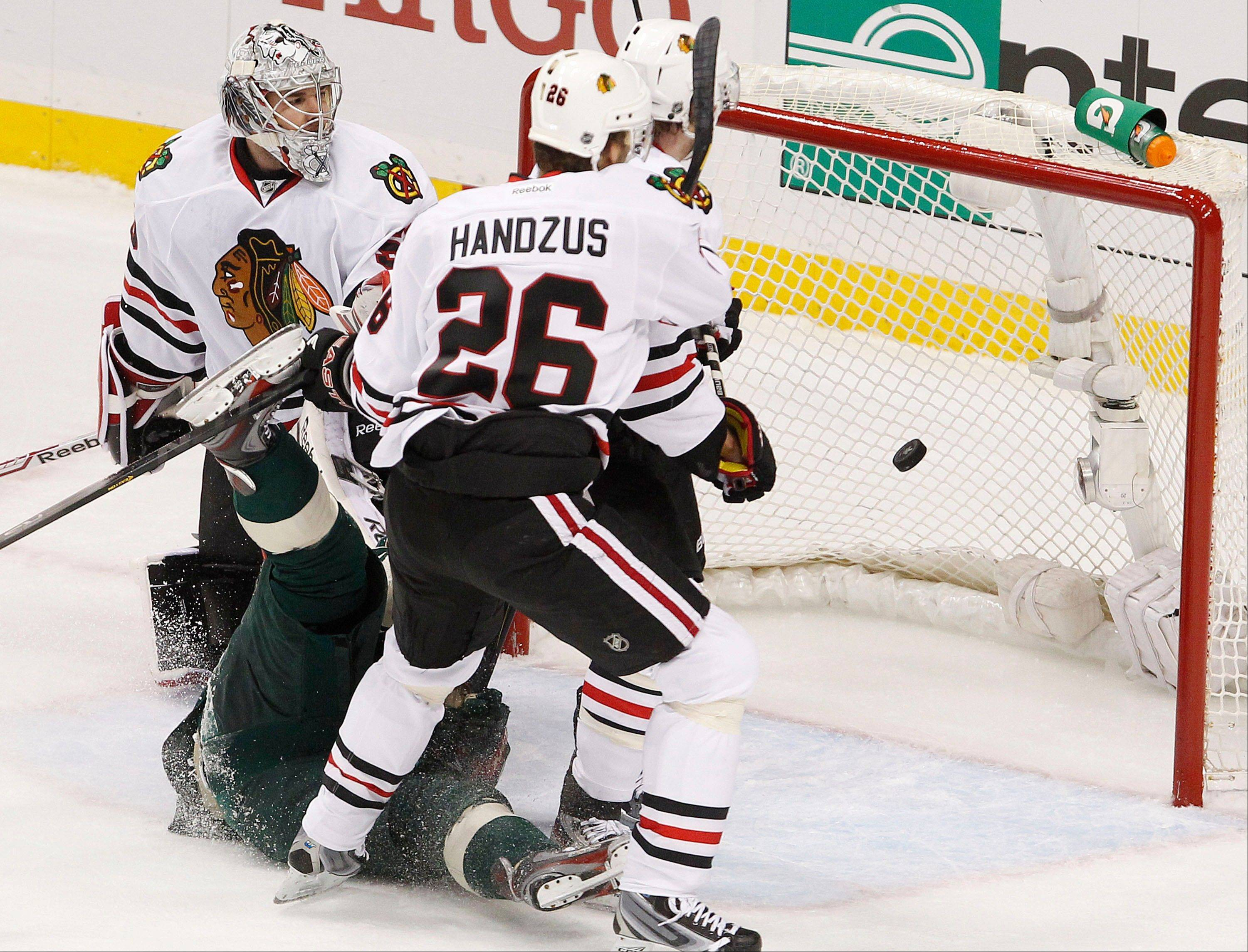 Blackhawks goalie Corey Crawford and center Michal Handzus watch as a Pierre-Marc Bouchard goal goes into the net in Sunday's first period in Game 3 of the Hawks' first-round playoff series with the Minnesota Wild.