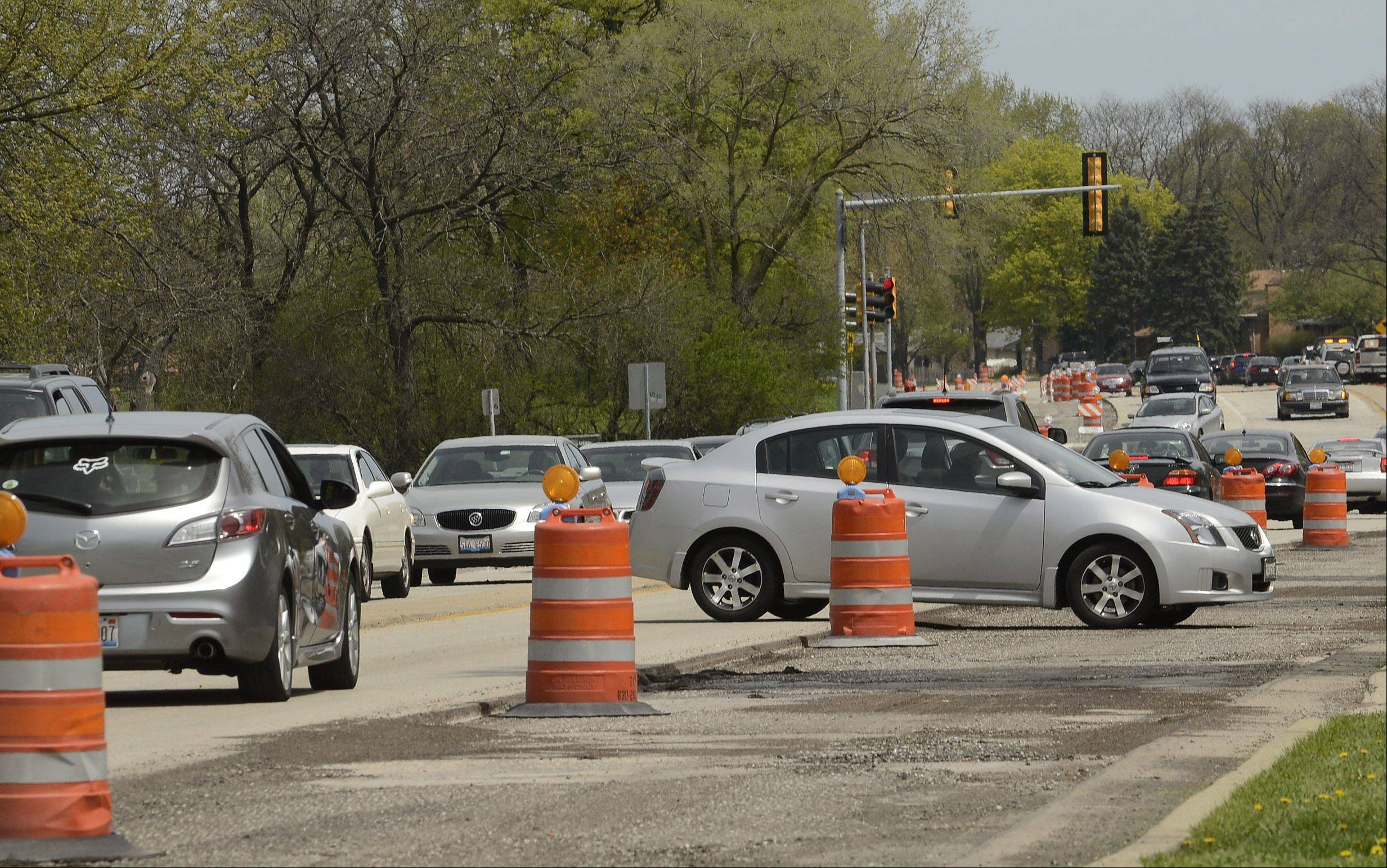 It's no fun for cars stuck in traffic along Arlington Heights Road in Elk Grove Village, where resurfacing and other roadwork will last into August.