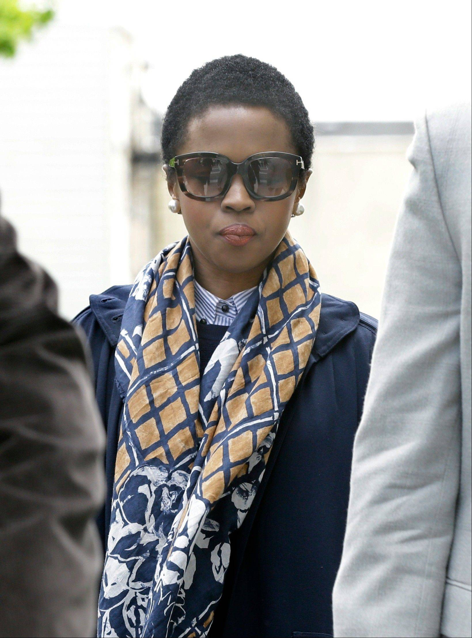 Eight-time Grammy winning singer Lauryn Hill, center, walks to federal court in Newark, N.J., Monday, May 6, for sentencing in her tax evasion case. Hill pleaded guilty last year to not paying federal taxes on $1.8 million earned from 2005 to 2007. She faces up to a year in prison on each of three counts.