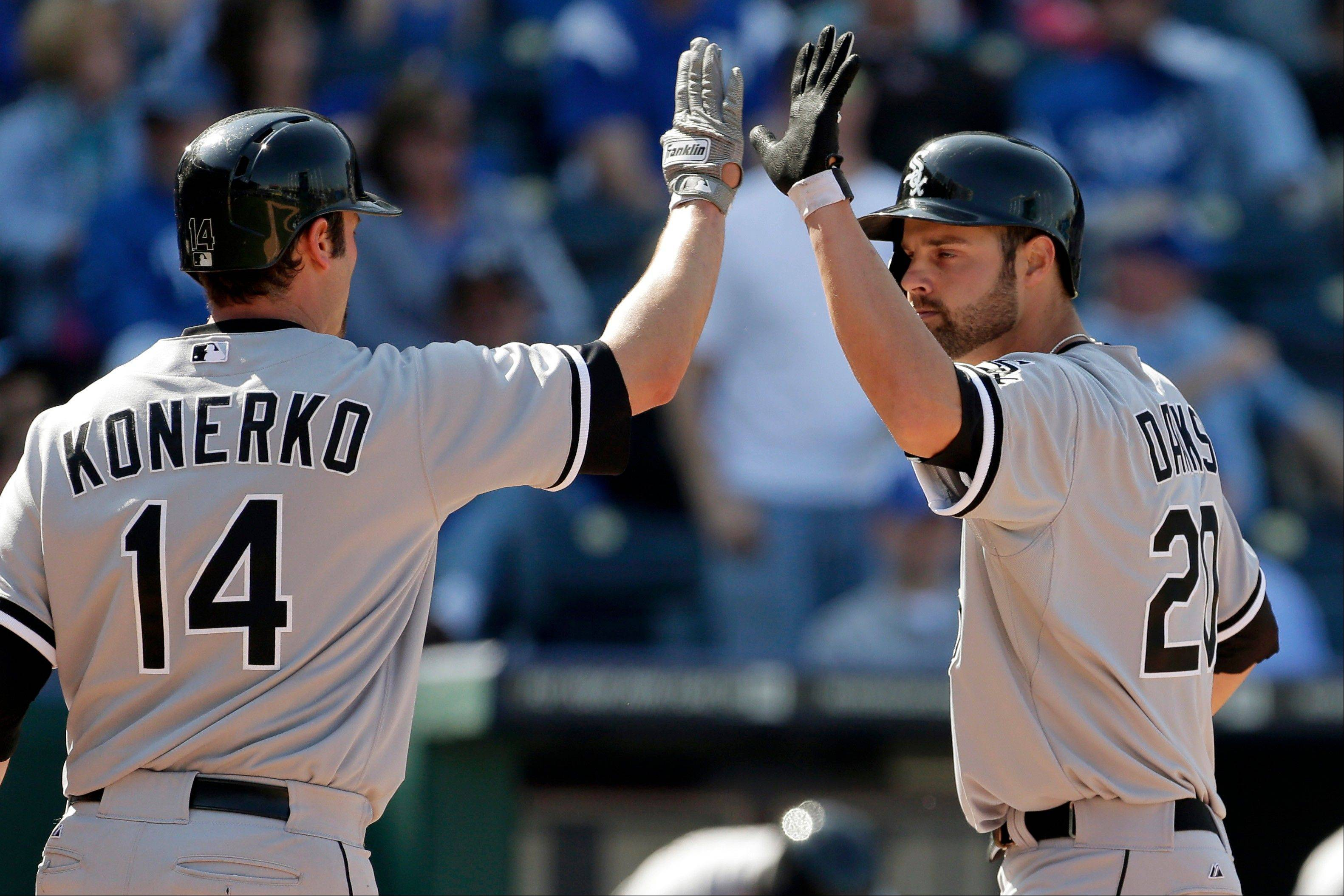 The White Sox� Jordan Danks, right, celebrates with Paul Konerko after hitting a solo home run in the 11th inning Monday against the Royals in Kansas City, Mo.