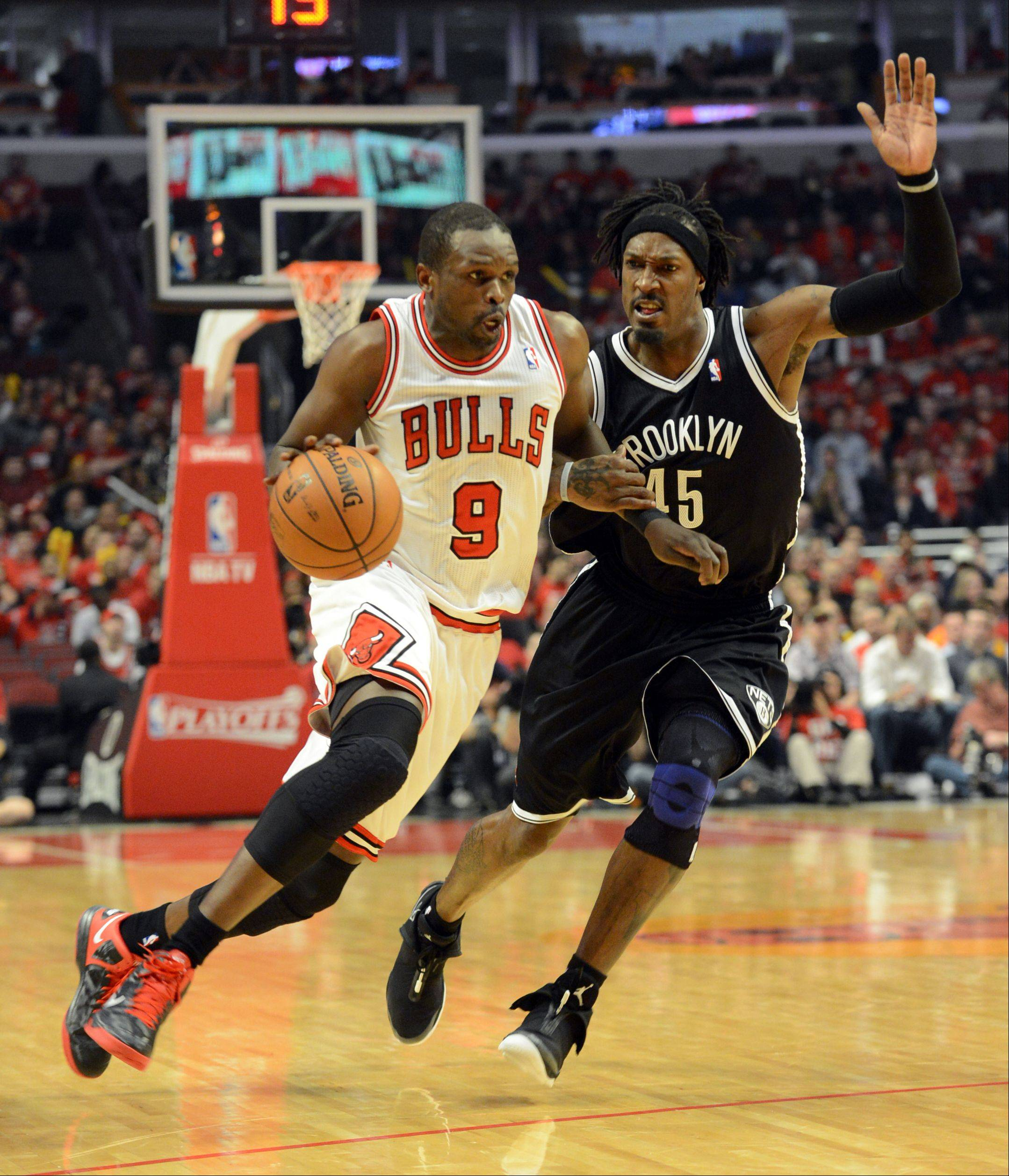 The Bulls Luol Deng drives past Brooklyn's Gerald Wallace during the second quarter of Game 4. Deng has been ruled out for tonight's game.