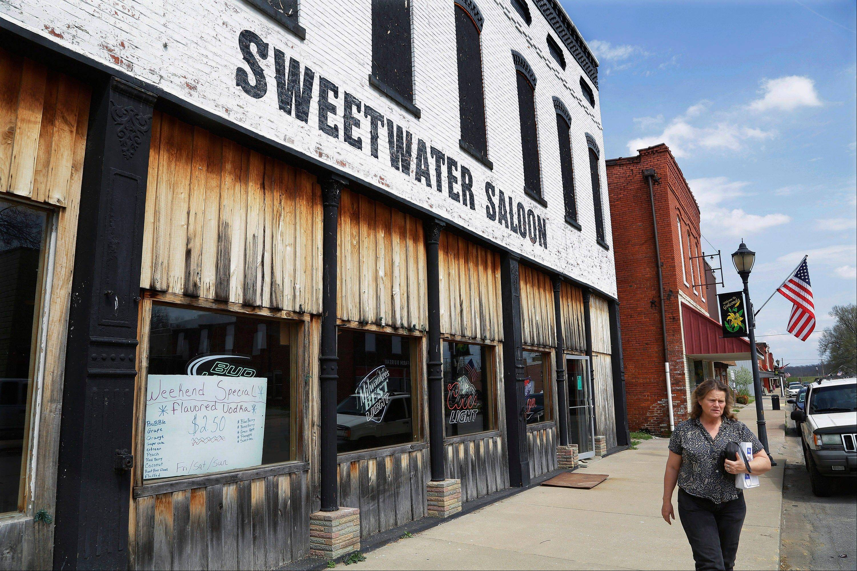 The Sweetwater Saloon dominates main street, taking up most of the block in Golconda, Ill. John Towns, owner of the Sweetwater Saloon says oil drilling would not bother him a bit. Southern Illinoisans have hopes and fears surrounding the high-volume oil and gas drilling that may be starting in the Shawnee National Forest.