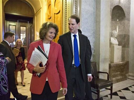 Sen. Lisa Murkowski, R-Alaska and Sen. Ron Wyden, D-Ore., right, leave the Senate floor after voting on legislation to collect sales tax on Internet purchases, on Capitol Hill in Washington, Monday,