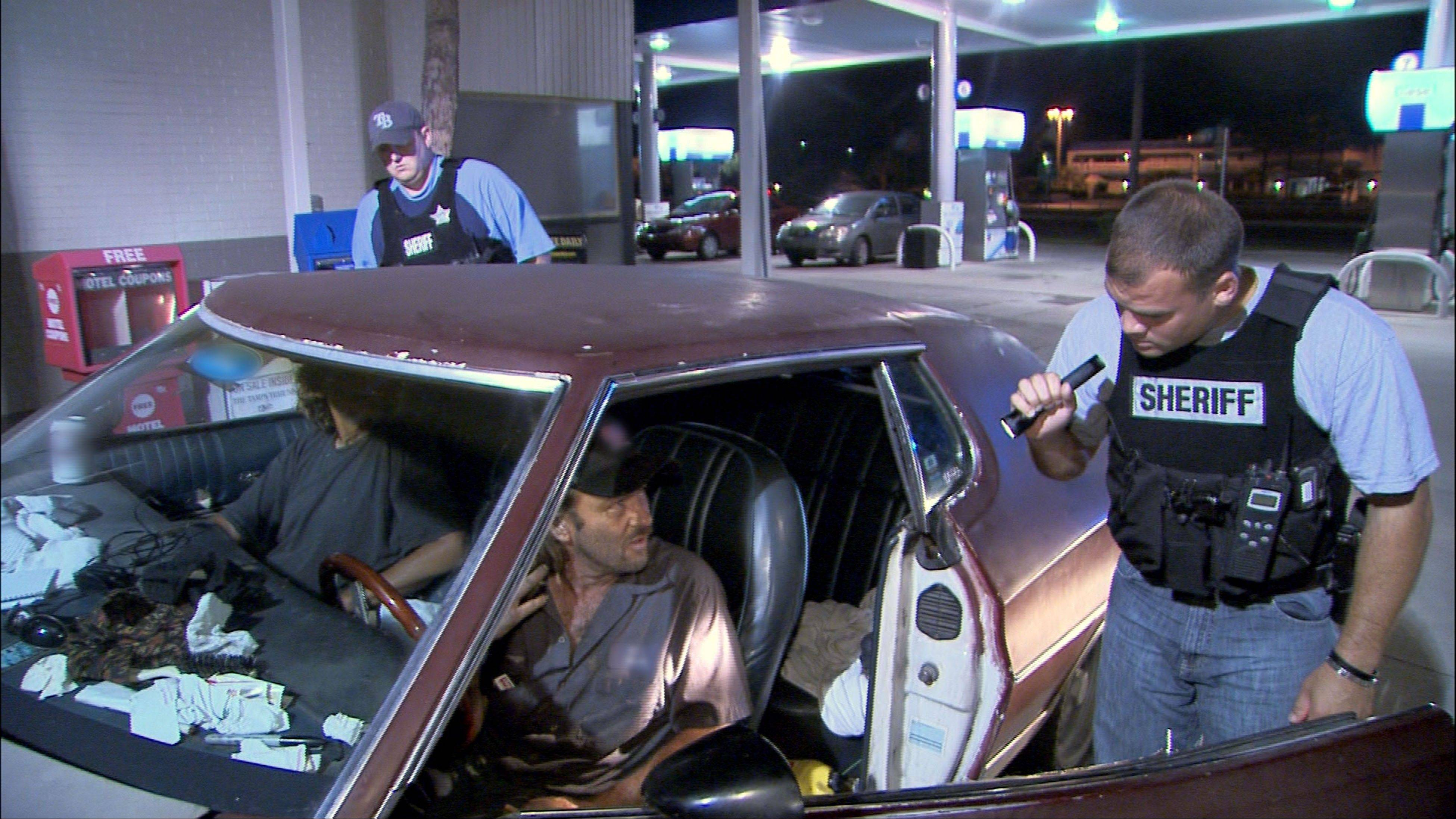 "Police officers in Hillsborough, Fla., interrogate two occupants of a car for suspicious drug activity in the ""Liar Liar #6"" episode of ""COPS."" The Saturday night television fixture is leaving Fox after 25 years to move to the Spike network."
