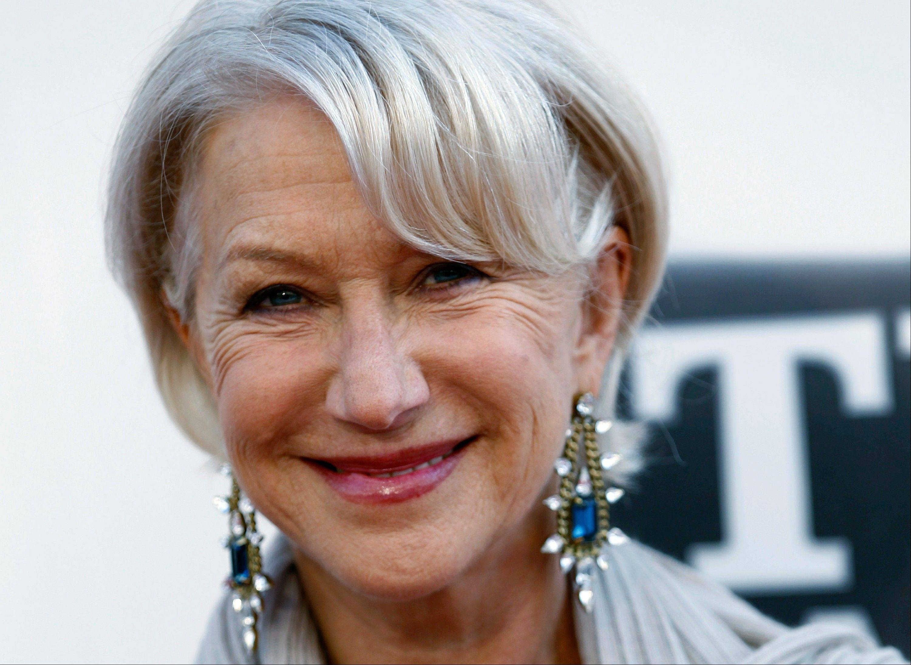 A troupe of street performers got a shock on Saturday when Helen Mirren, dressed as Queen Elizabeth II, emerged from a London theater during the intermission of her performance, to berate them for disrupting her show.