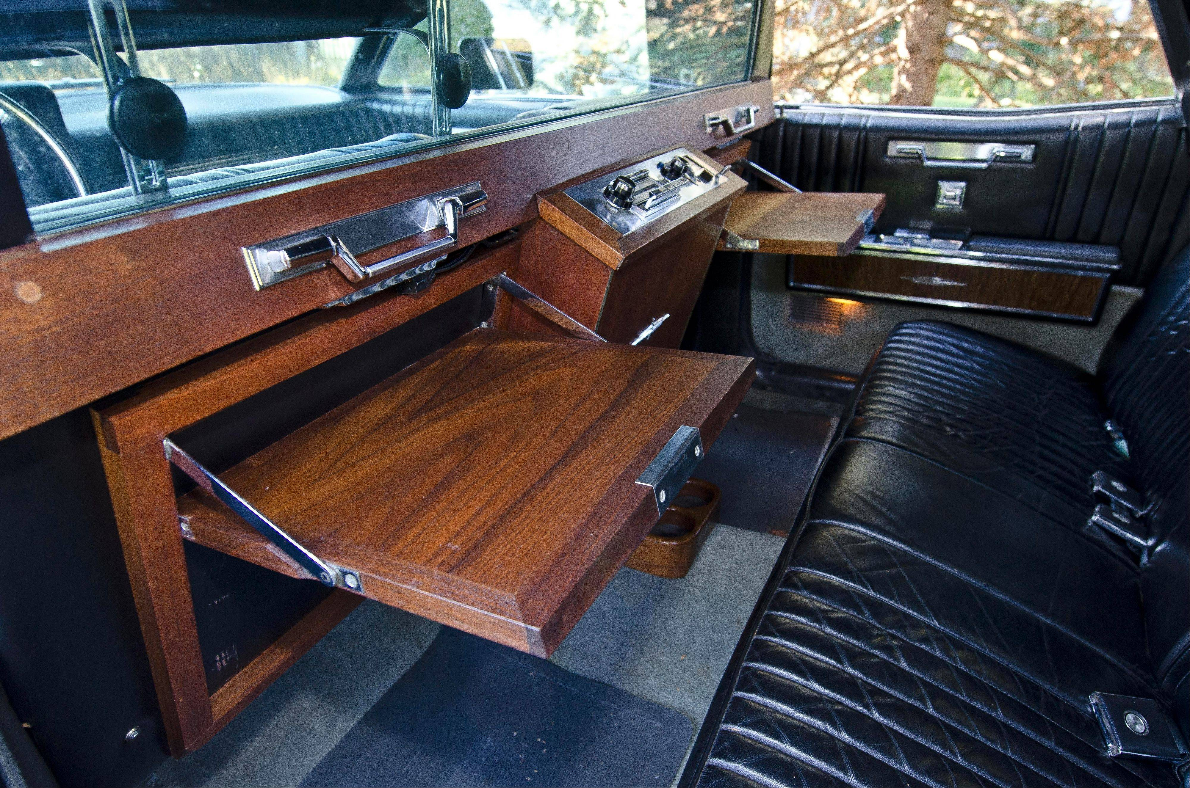While a variety of luxuries came standard, buyers could purchase upgrades to their limousine interiors. Searle's Lincoln came with work stations.