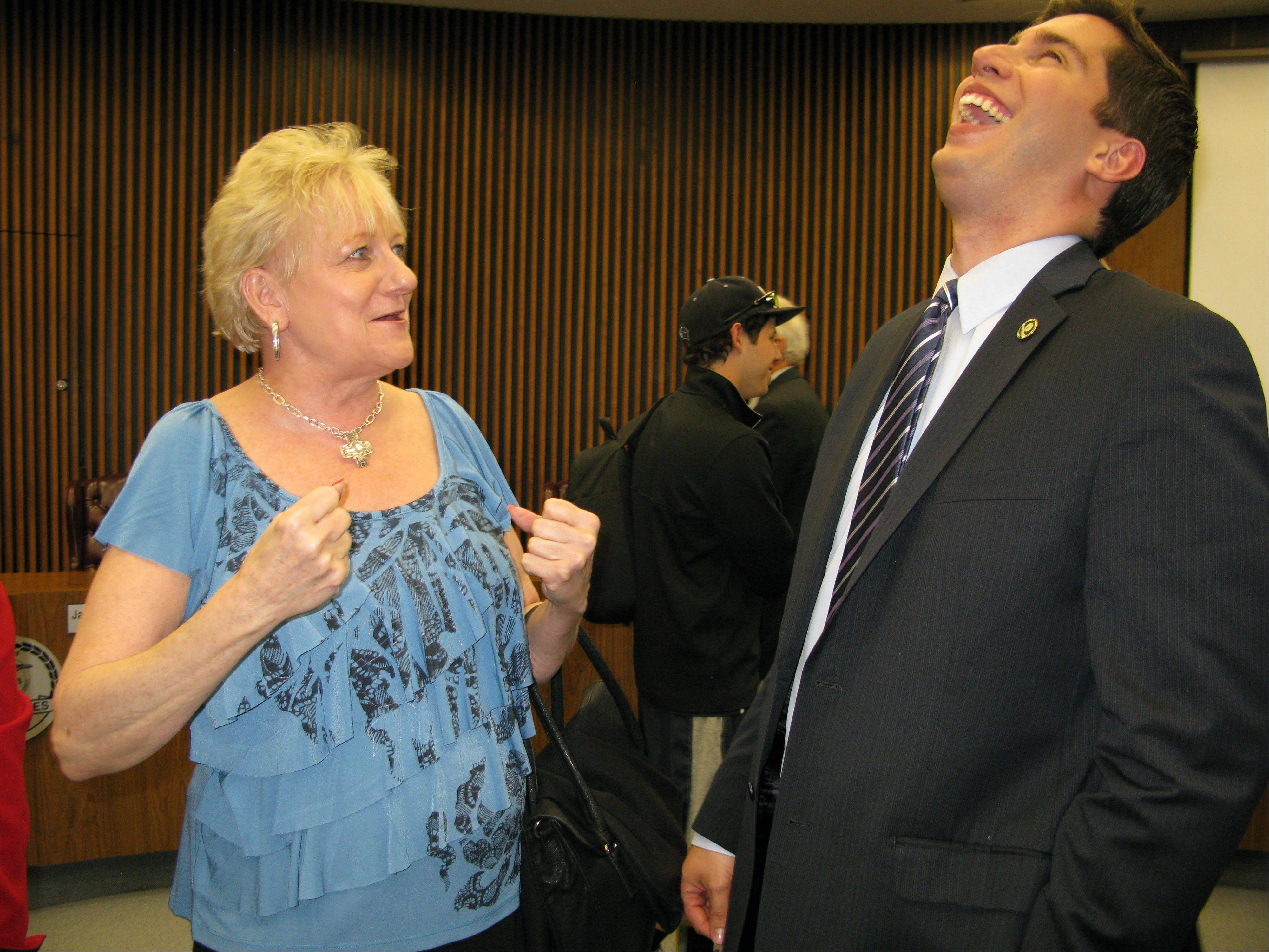 Des Plaines Mayor Matt Bogusz shares a laugh with Debbie Crowell, who worked on his election campaign, after being sworn in Monday.