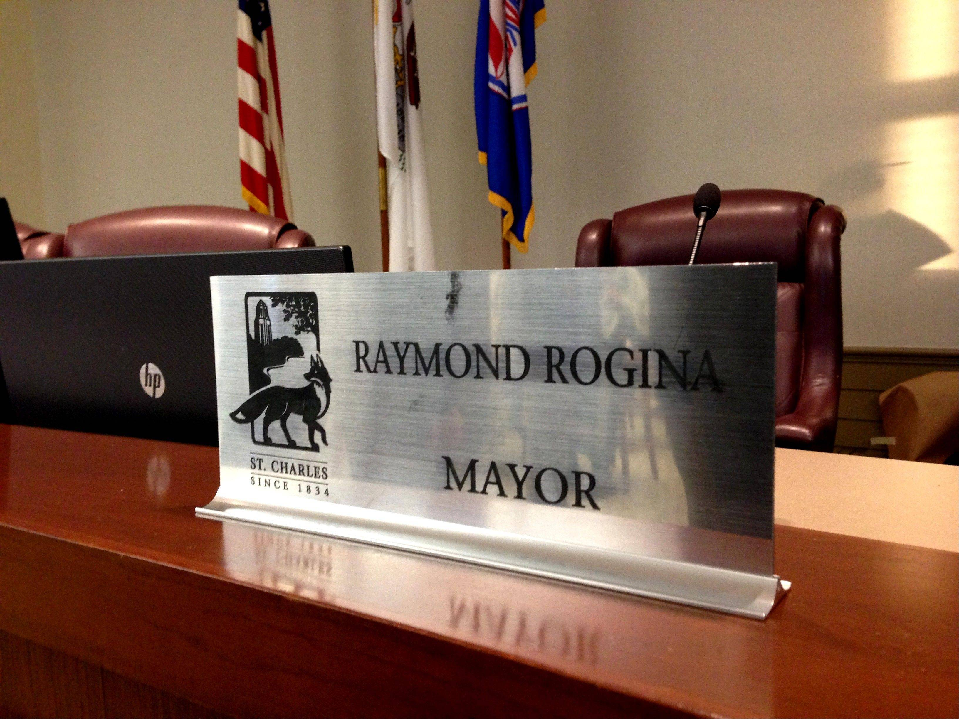 Ray Rogina took his seat as the new mayor of St. Charles on Monday night.