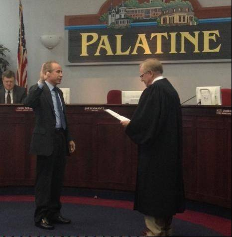 Judge William O. Maki administers the oath of office to Tim Millar as District 1 councilman.