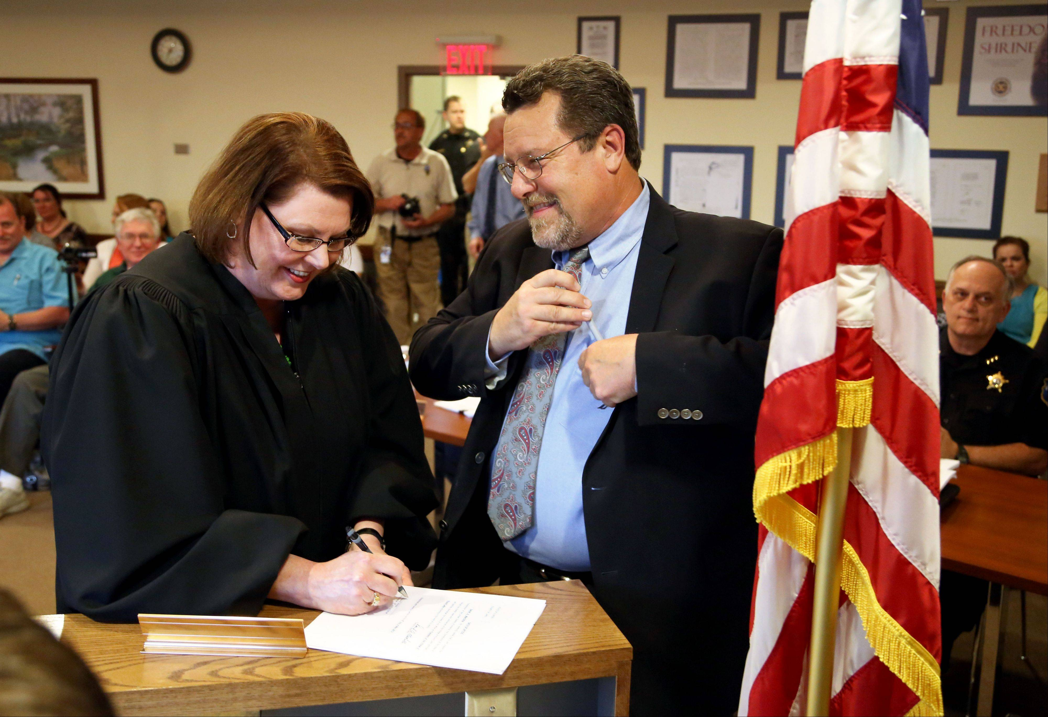 Daniel MacGillis is all smiles after being sworn in as the new mayor of Round Lake by Judge Diane Winte during the village board meeting Monday night.