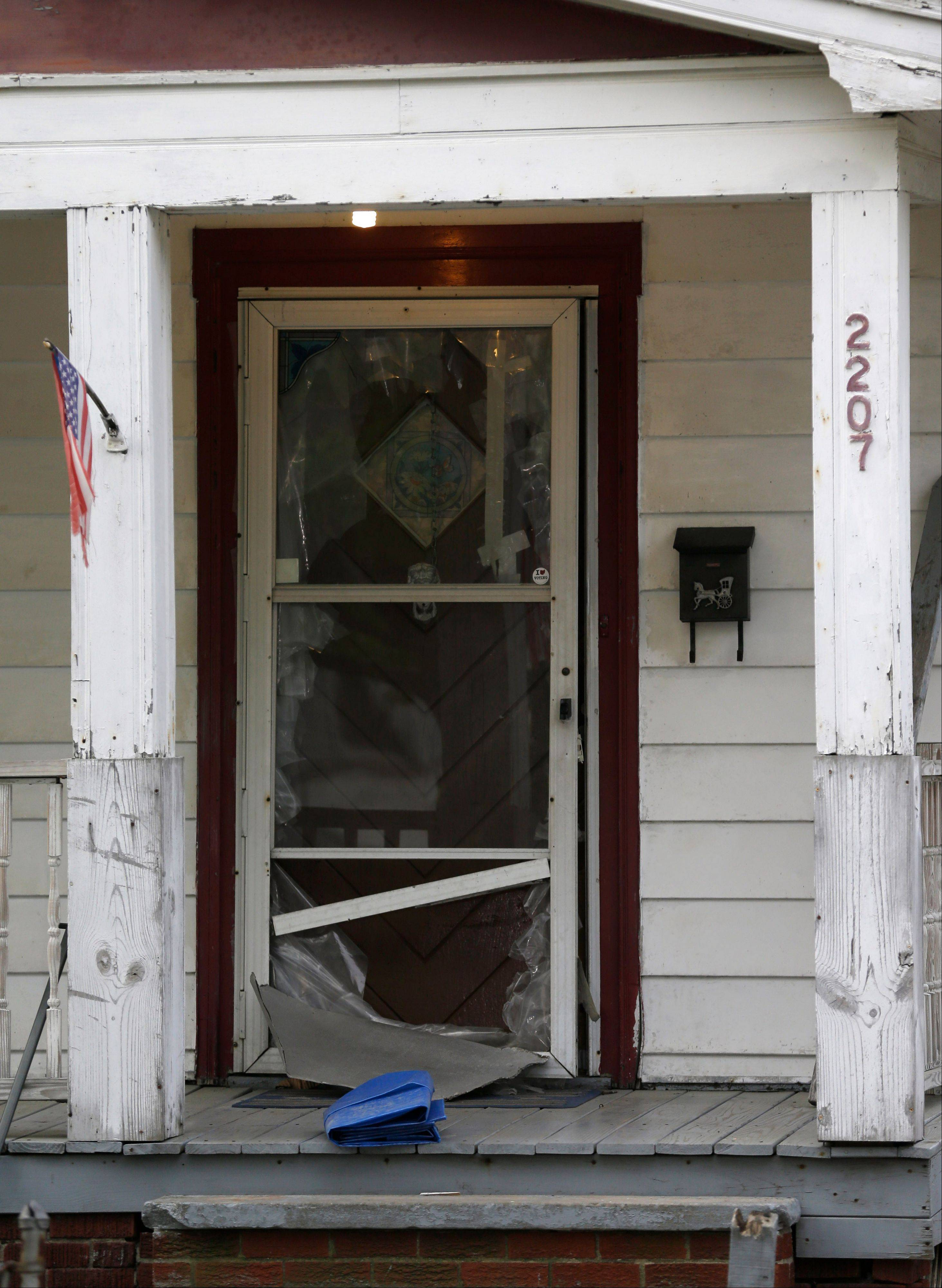 The front door of a house where three women escaped in Cleveland. Amanda Berry, Gina DeJesus and Michelle Knight, who went missing separately about a decade ago, were found in the home just south of downtown Cleveland Monday, May 6, and likely had been tied up during years of captivity, said police, who arrested three brothers.