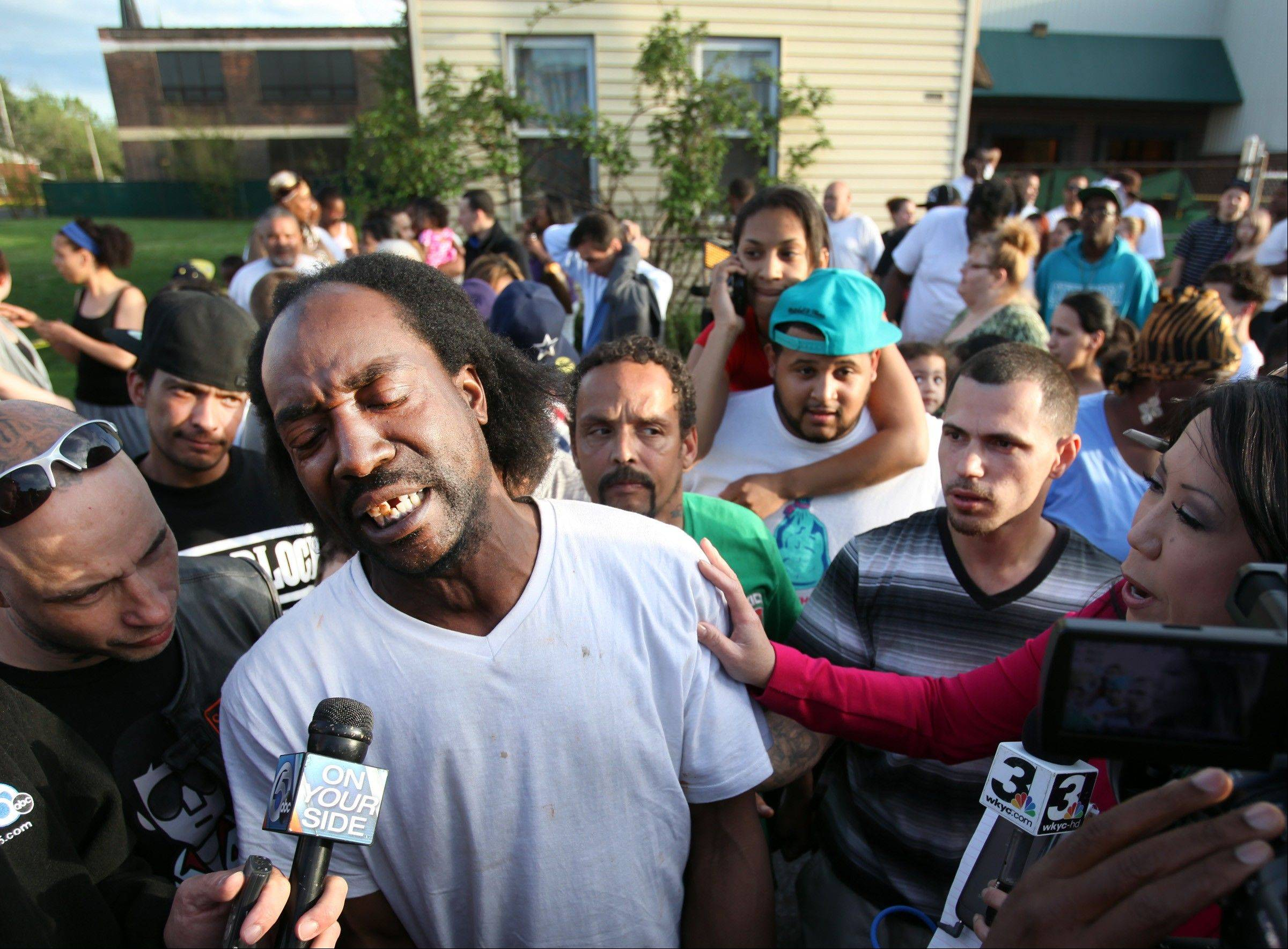 Neighbor Charles Ramsey speaks to media near the home where three missing women were rescued in Cleveland, on Monday, May 6, 2013. Ramsey heard screaming Monday and saw Berry, whom he didn't recognize, at a door that would open only enough to fit a hand through. He said she was trying desperately to get outside and pleaded for help to reach police.