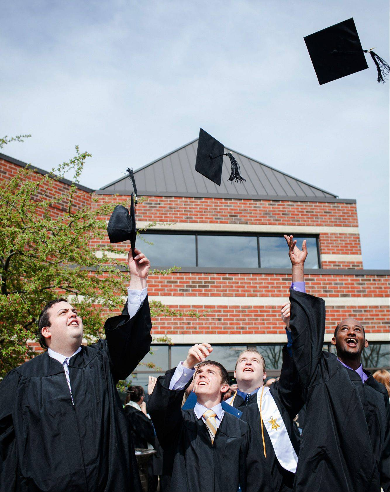 Graduates of the School of Leadership and Business celebrate following graduation Saturday at Judson University in Elgin.