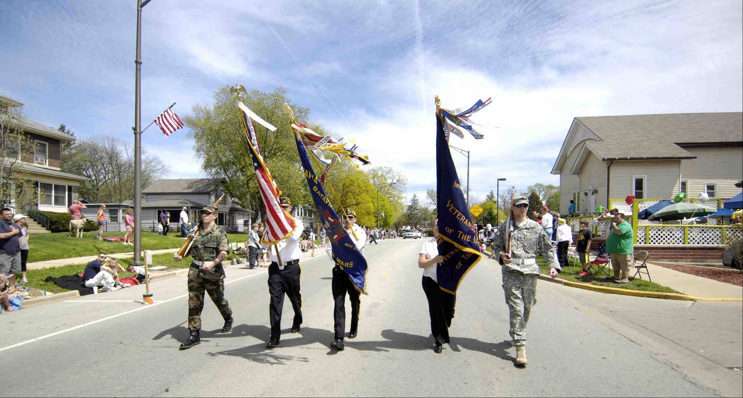 "The Batavia VFW color guard leads the Batavia Loyalty Day Parade on Sunday along Wilson Street. ""The VFW Tree of Life"" was the theme."