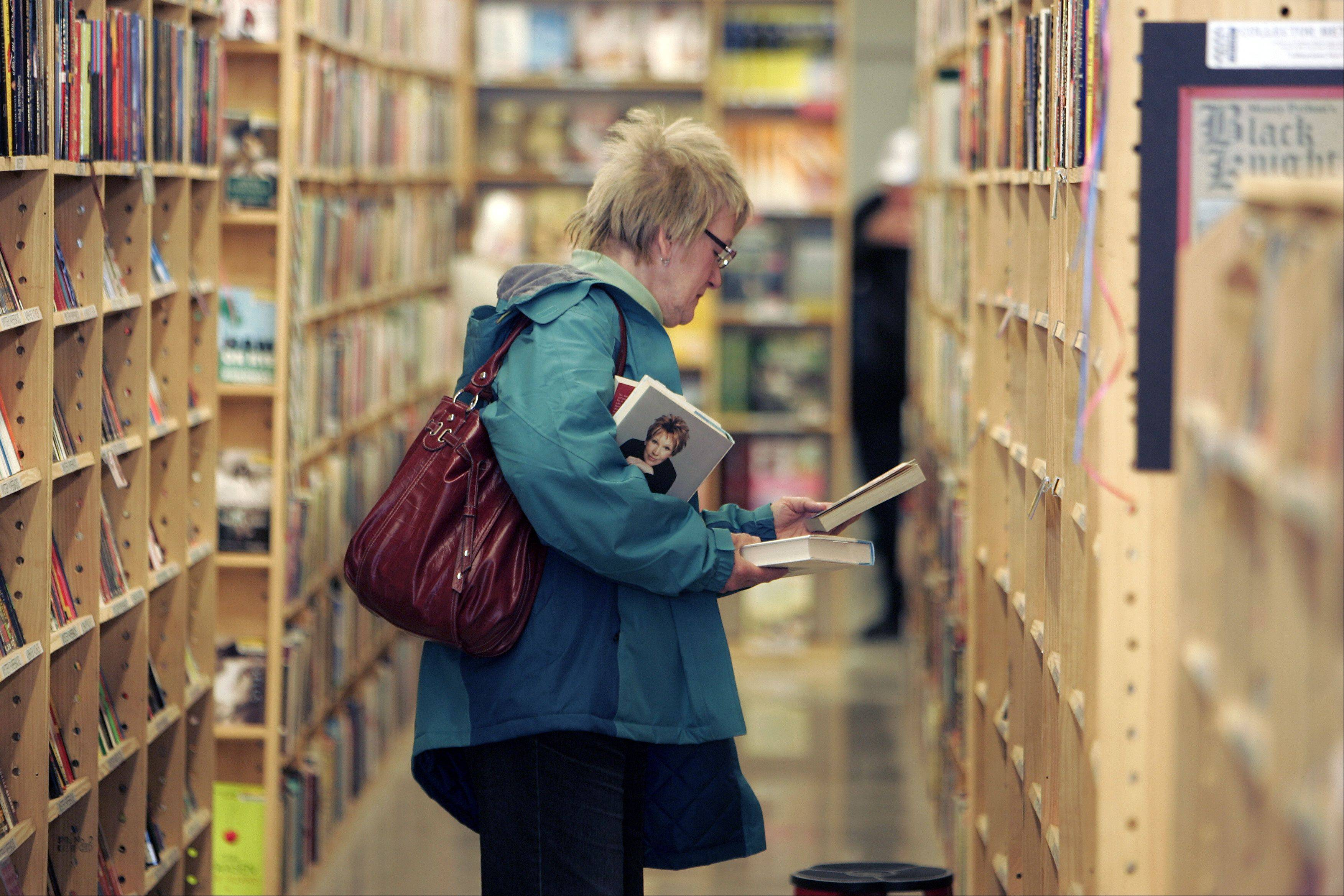 Alice Cachura of Chicago looks over the selection at Half Price Books at the store's recent grand opening at Algonquin Commons.