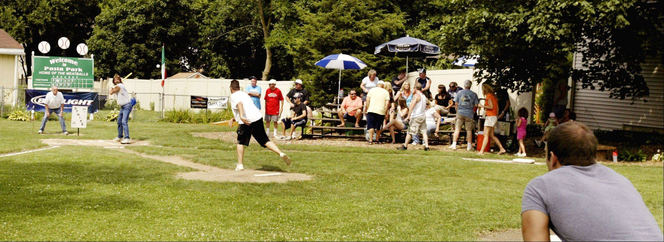 Lombard's new village president, Keith Giagnorio, enjoys playing whiffle ball with friends and neighbors at Pasta Park, the informal ballfield next to his house.