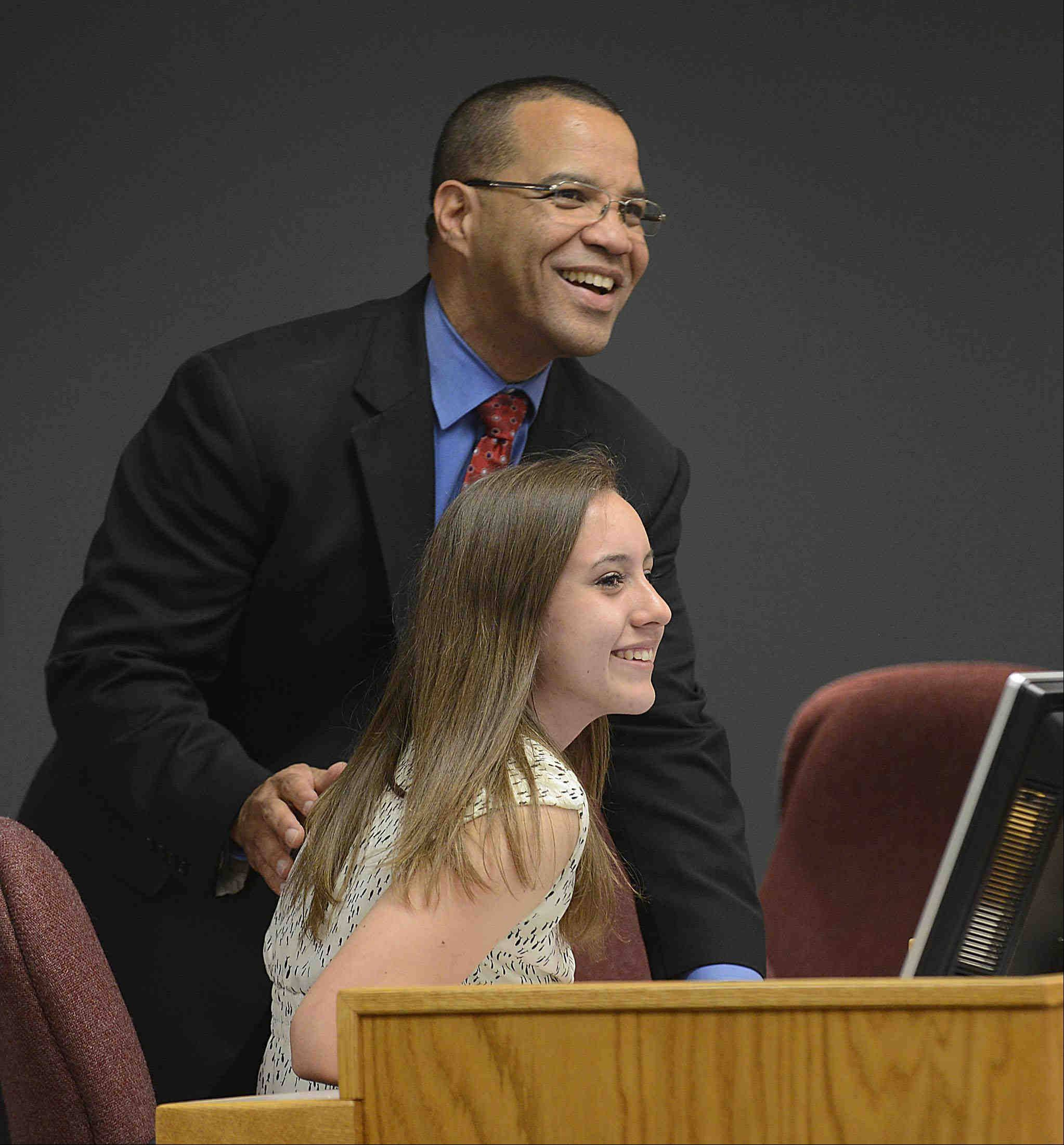 Superintendent Jos� Torres and outgoing student representative Diana Castillo laugh with the audience before the U-46 board meeting starts Monday in Elgin.