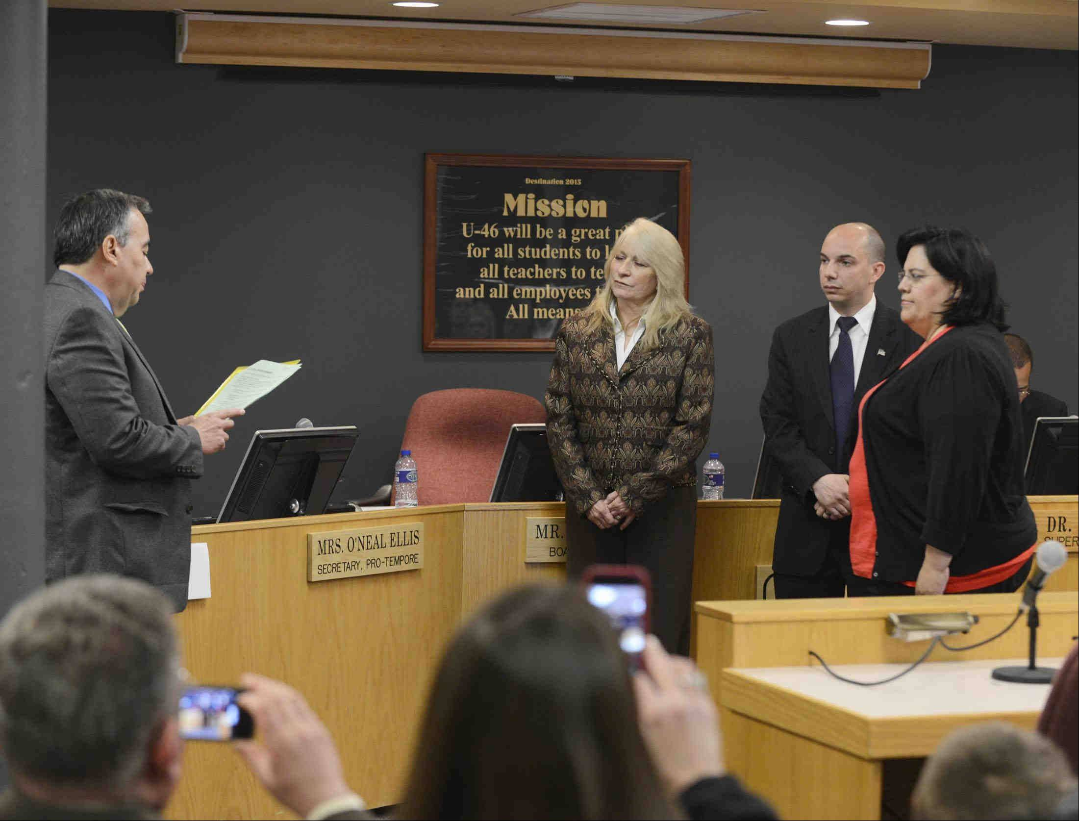 Donna Smith, middle left, takes her fourth oath of office as she is sworn Monday night with new U-46 board members Veronica Noland and Frank Napolitano in Elgin. Smith was re-elected board president by her peers.