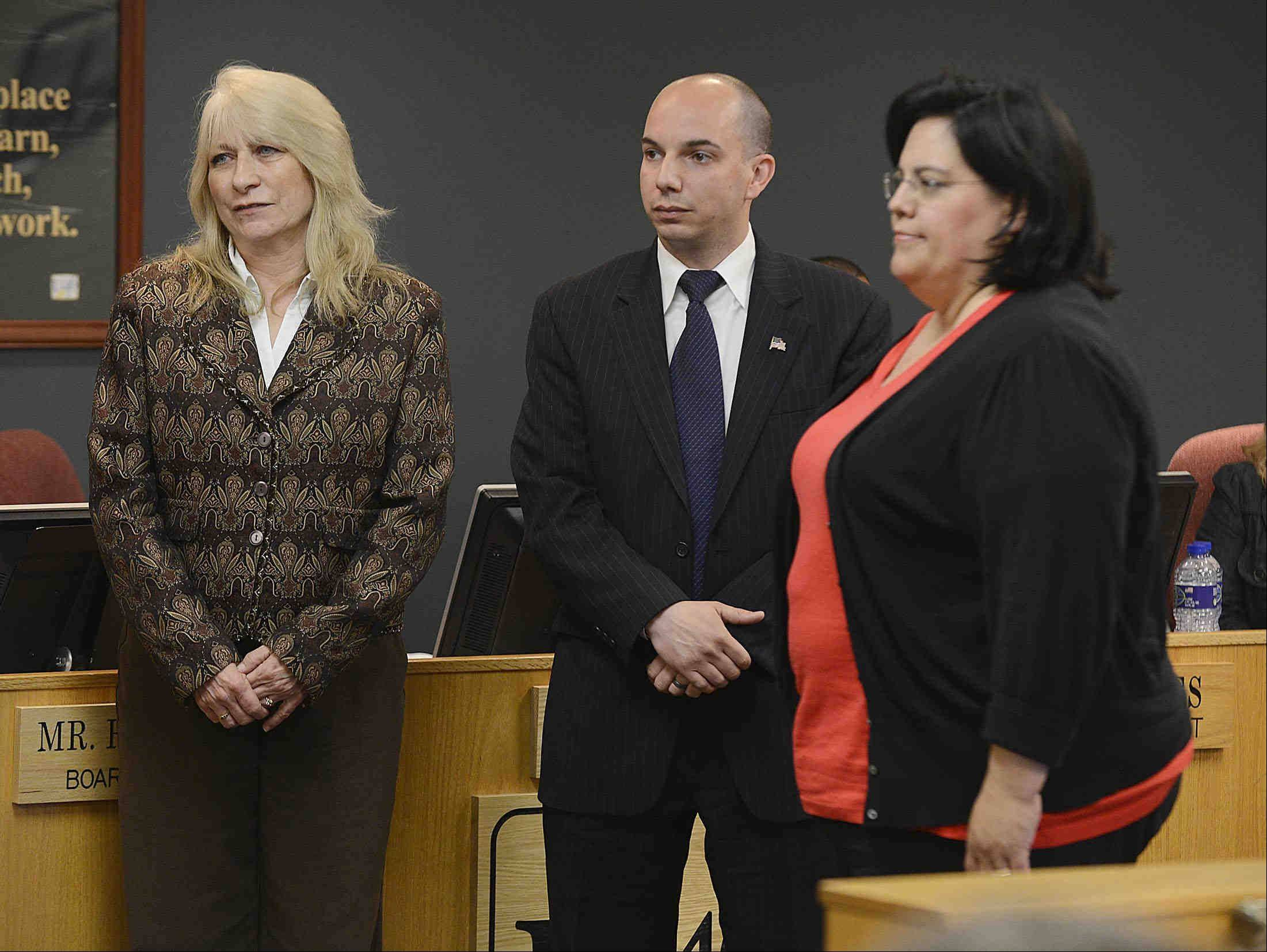 Donna Smith, middle left, takes her fourth oath of office as she is sworn in Monday night with new U-46 board members Veronica Noland and Frank Napolitano in Elgin. Smith was re-elected board president by her peers.