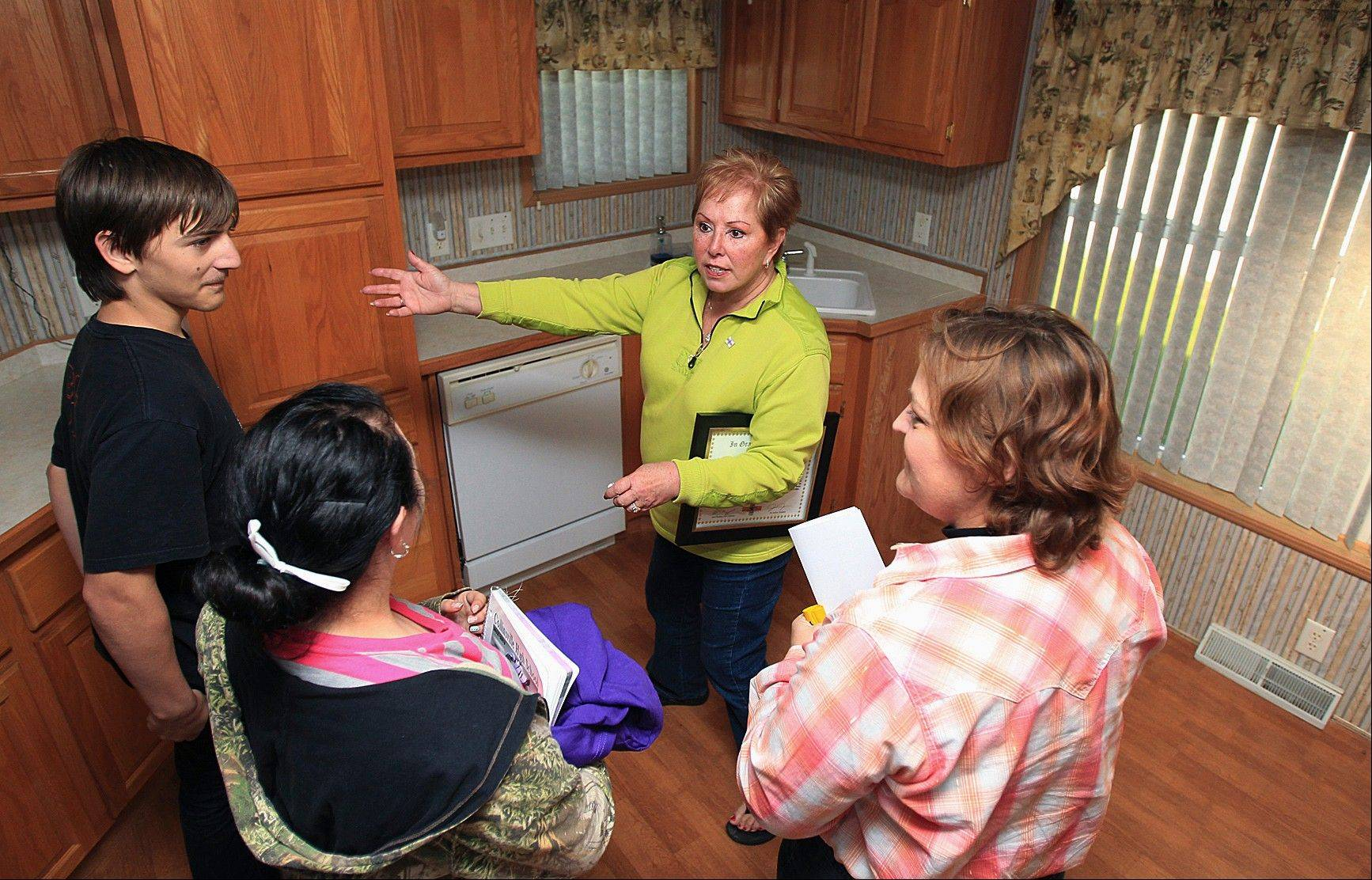 Associated Press  Anita Johnson gives a tour of a home she and her husband, Earl, donated to the Walter family in Collinsville