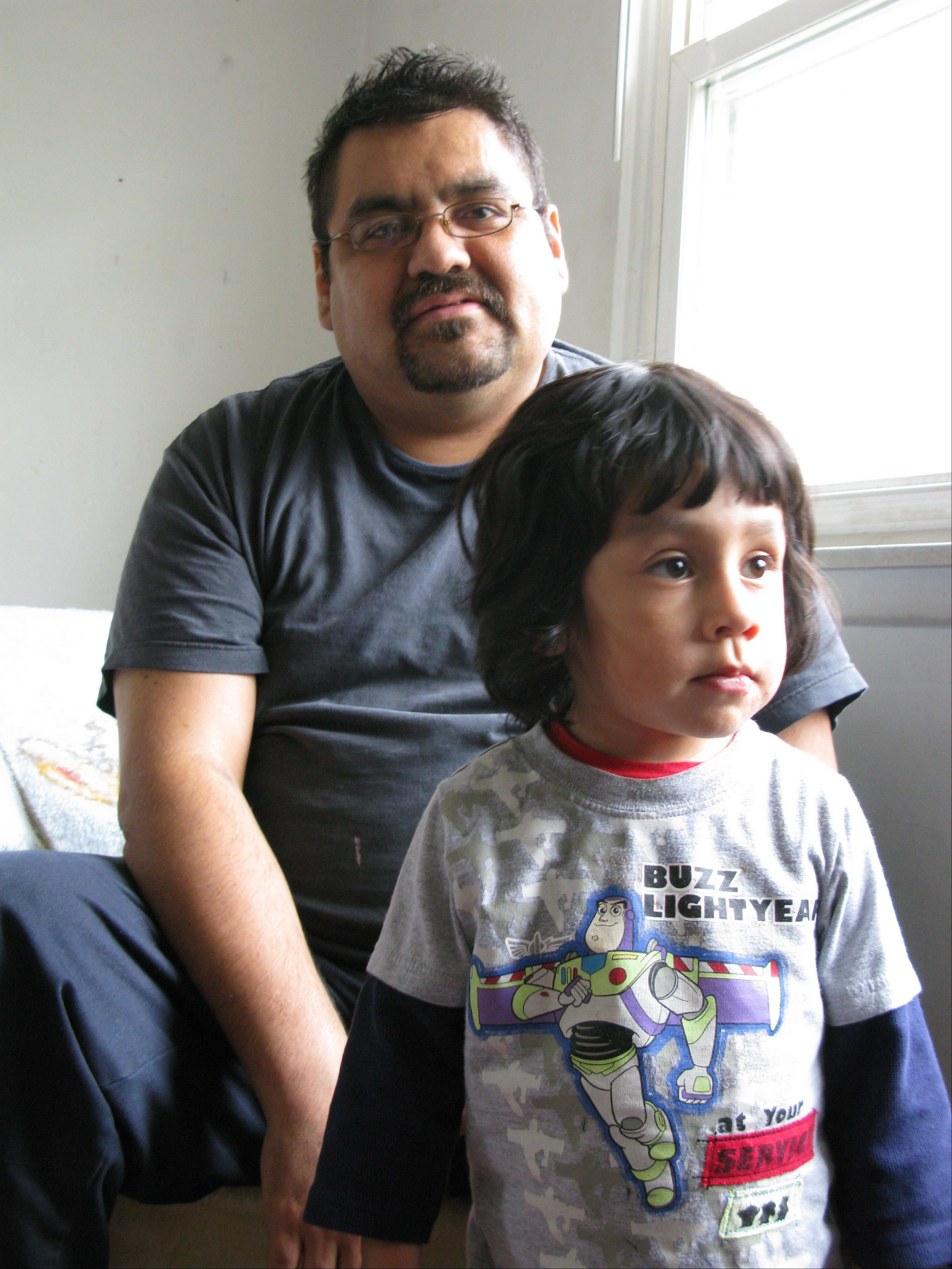 Neftali Hernandez, 35, pictured here with his nephew, Joel, suffers from aplastic anemia and is in need of a donor match for a bone-marrow transplant.