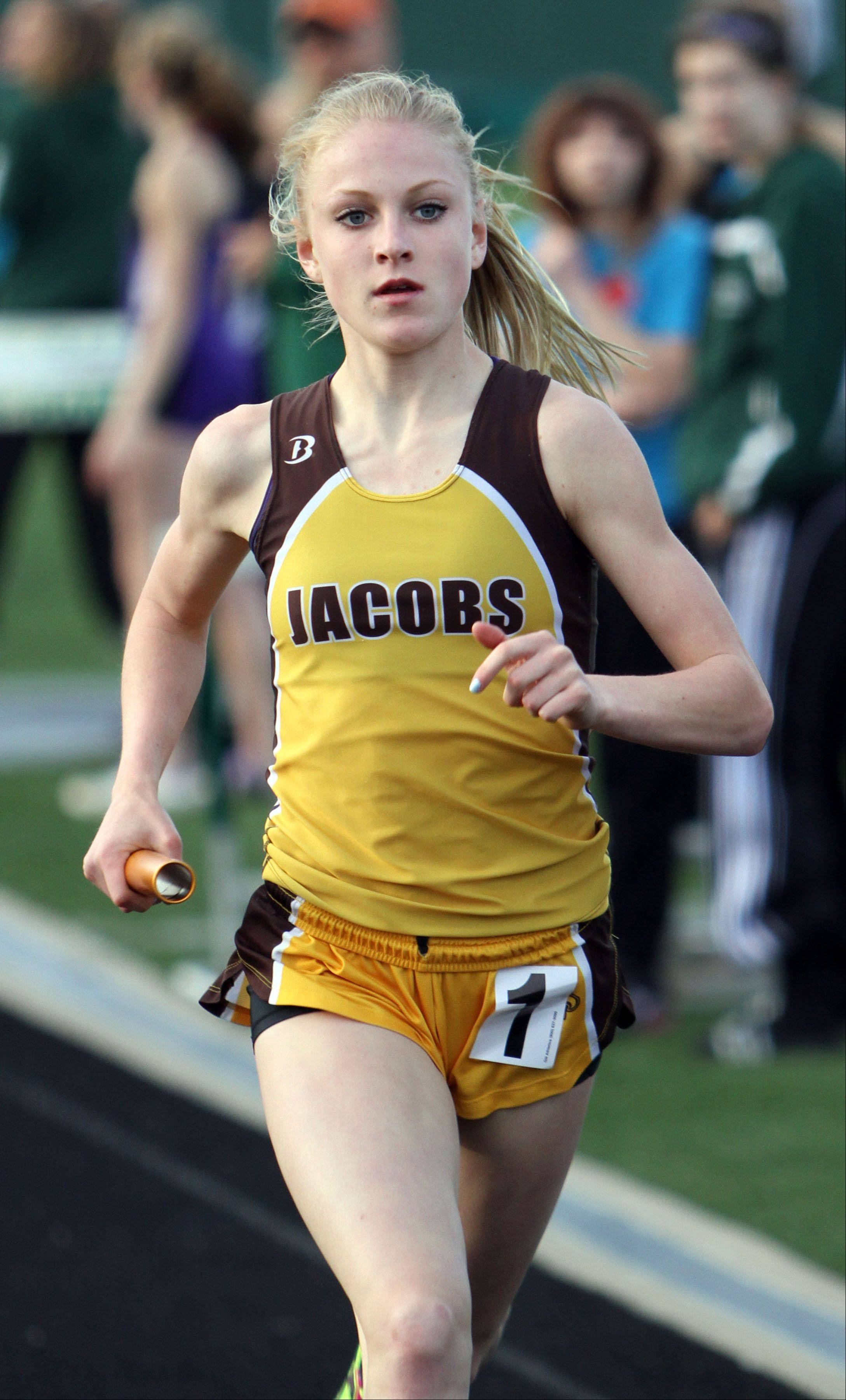 Jacobs Lauren Van Vlierbergen anchors the Golden Eagles' win in the 3,200 meter relay during the Fox Valley Conference girls track meet Monday at Grayslake Central High School.