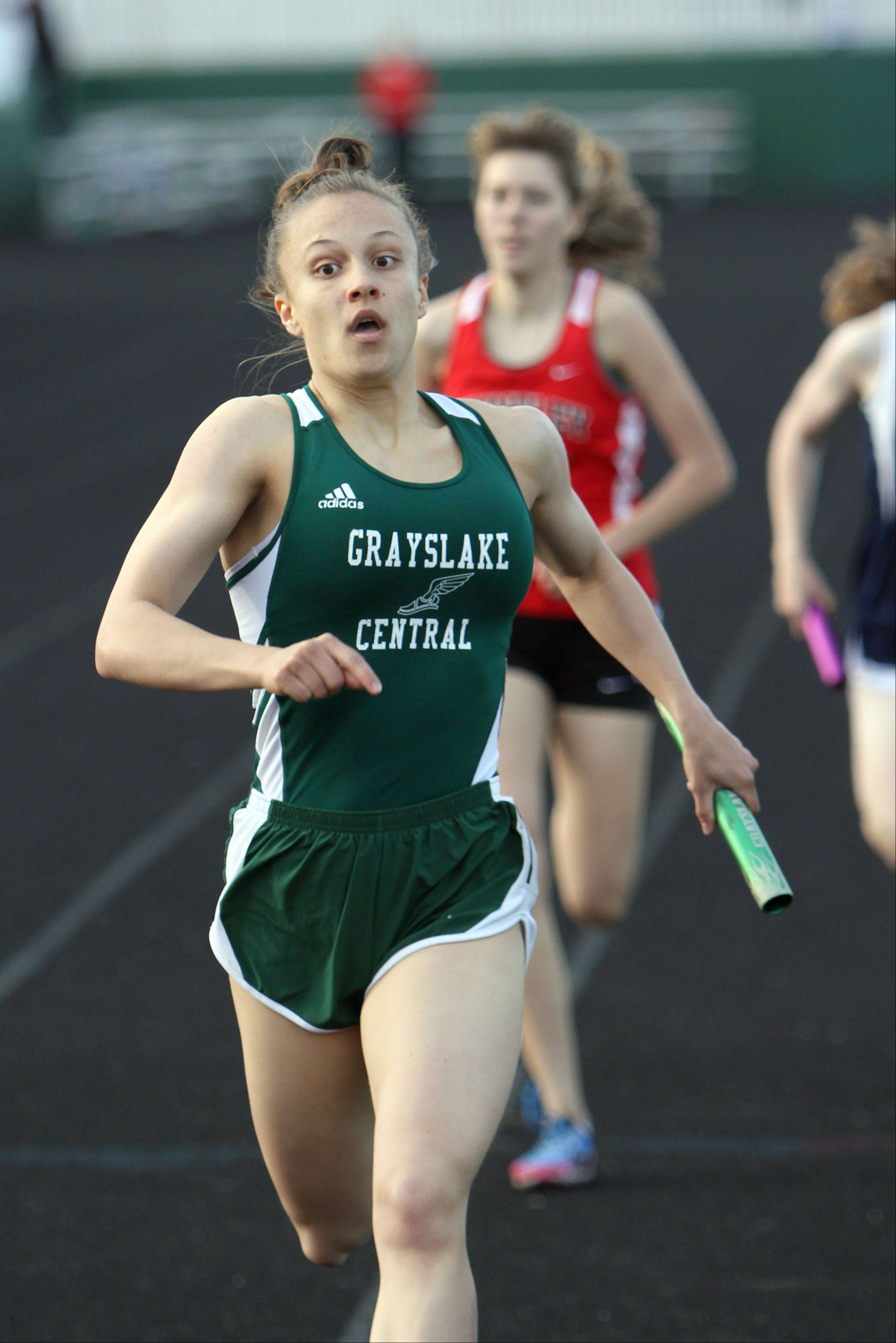 Grayslake Central's Claire Haggerty powers to the finish line in the 3,200-meter relay during the Fox Valley Conference girls track meet Monday at Grayslake Central High School.