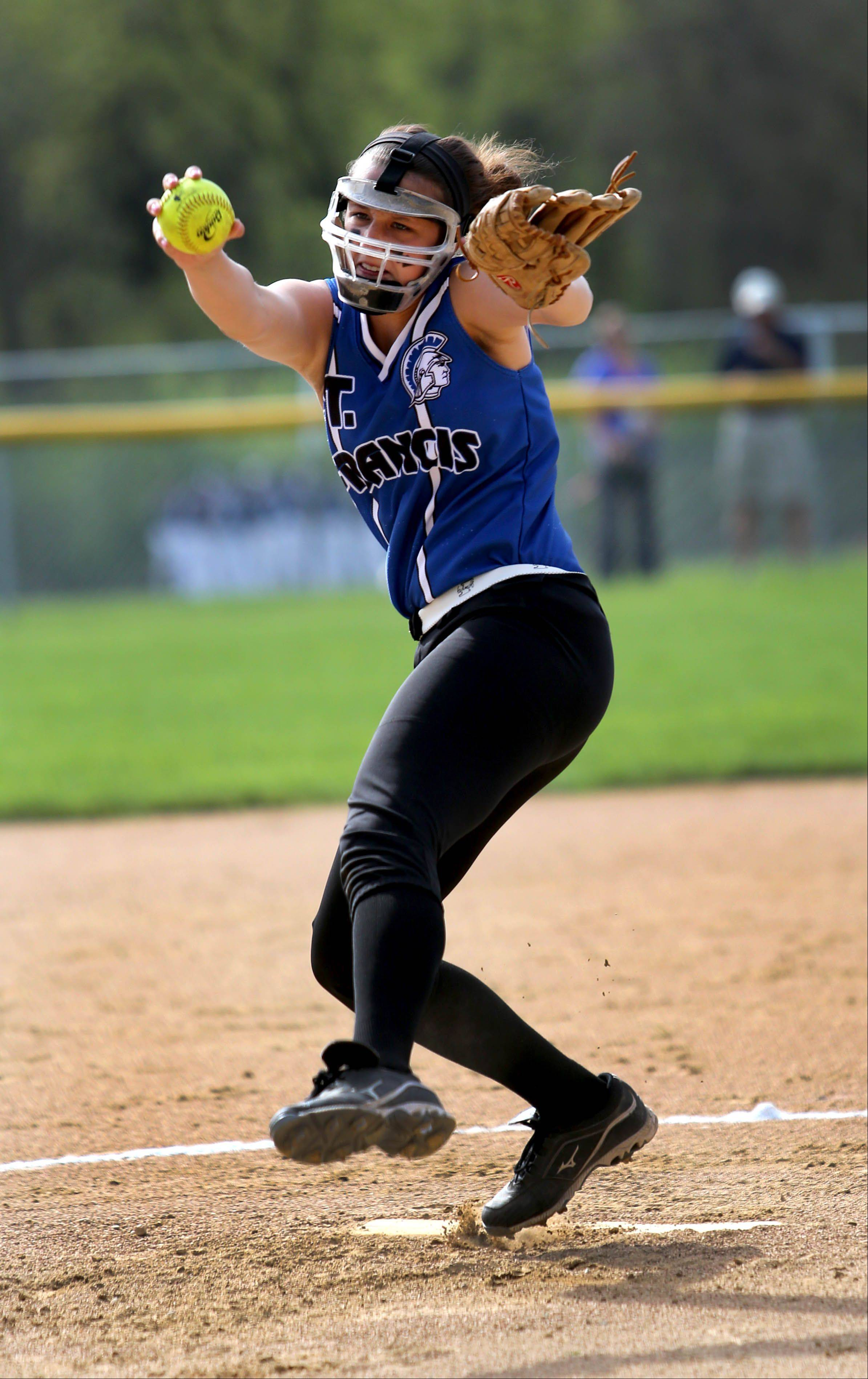 Maggie Remus of St. Francis winds up her pitch against Montini Catholic during girls softball on Monday in Wheaton.