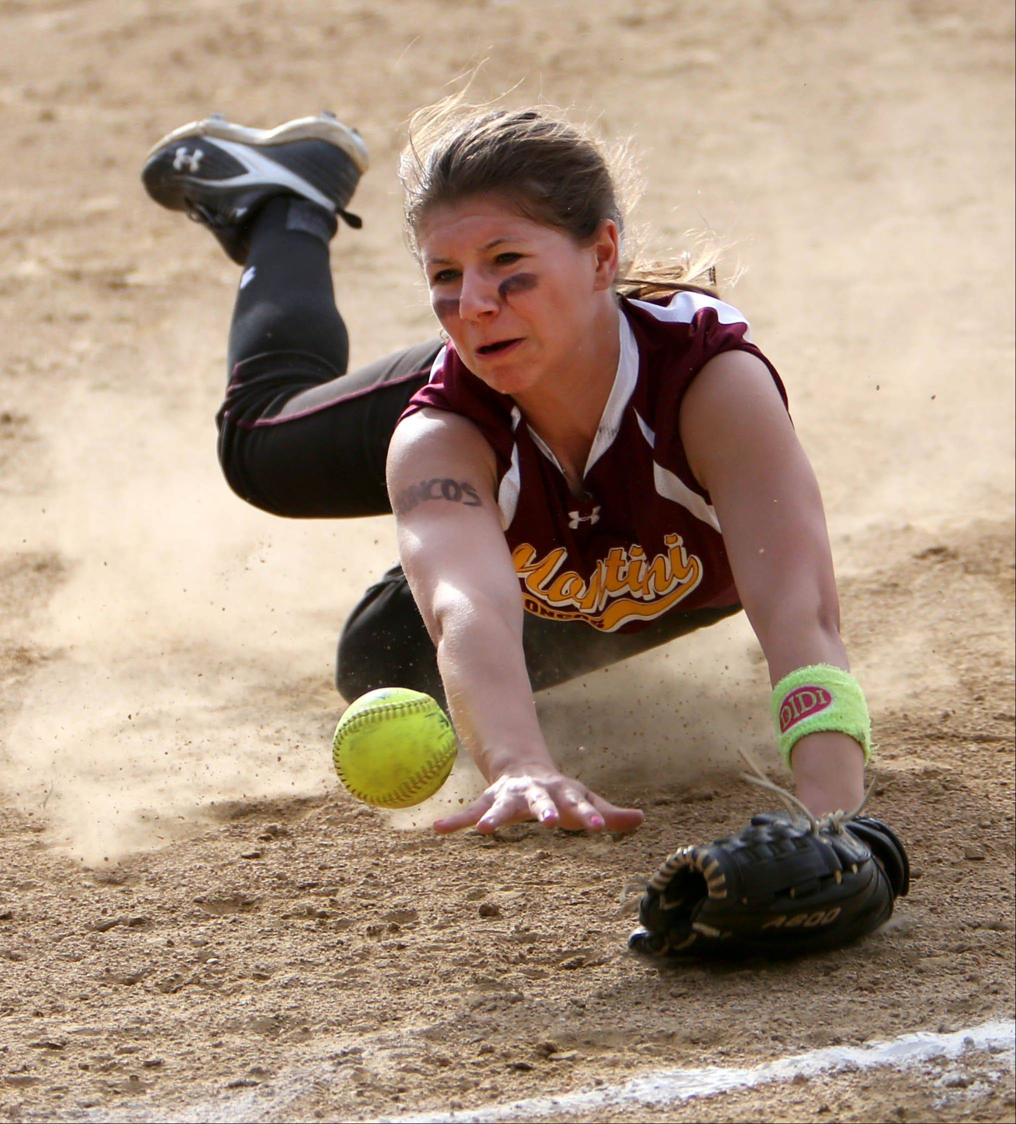 Montini Catholic pitcher Lauren Trojnar dives for a ball in the infield during girls softball against St. Francis on Monday in Wheaton.